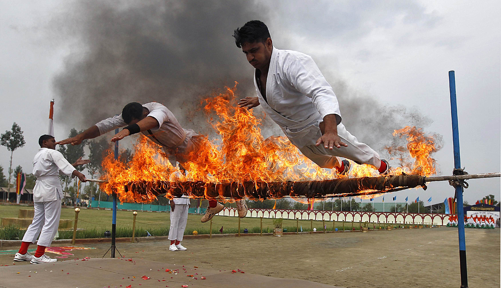 India's CRPF personnel perform a stunt during the passing out parade  in Humhama, on the outskirts of Srinagar...India's Central Reserve Police Force (CRPF) personnel perform a stunt during the passing out parade in Humhama, on the outskirts of Srinagar August 28, 2014. According to authorities from CRPF, 368 new policemen were formally inducted into the force after completing a 44-week rigorous training course and will be deployed in different parts of India. REUTERS/Danish Ismail (INDIAN-ADMINISTERD KASHMIR - Tags: MILITARY SOCIETY TPX IMAGES OF THE DAY)