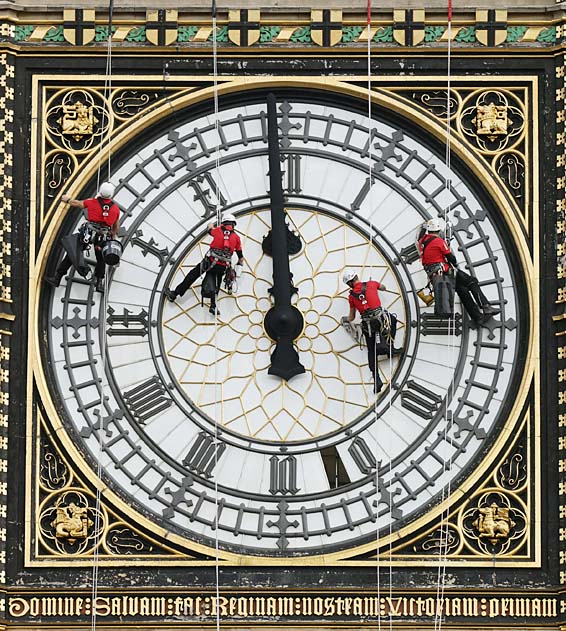 Great Clock maintenance...A specialist technical abseil team clean and inspect one of the four faces of the Great Clock, otherwise known as Big Ben, at the Houses of Parliament, in central London, as they undertake essential maintenance and cleaning of the four faces. PRESS ASSOCIATION Photo. Picture date: Monday August 18, 2014. Photo credit should read: Yui Mok/PA Wire