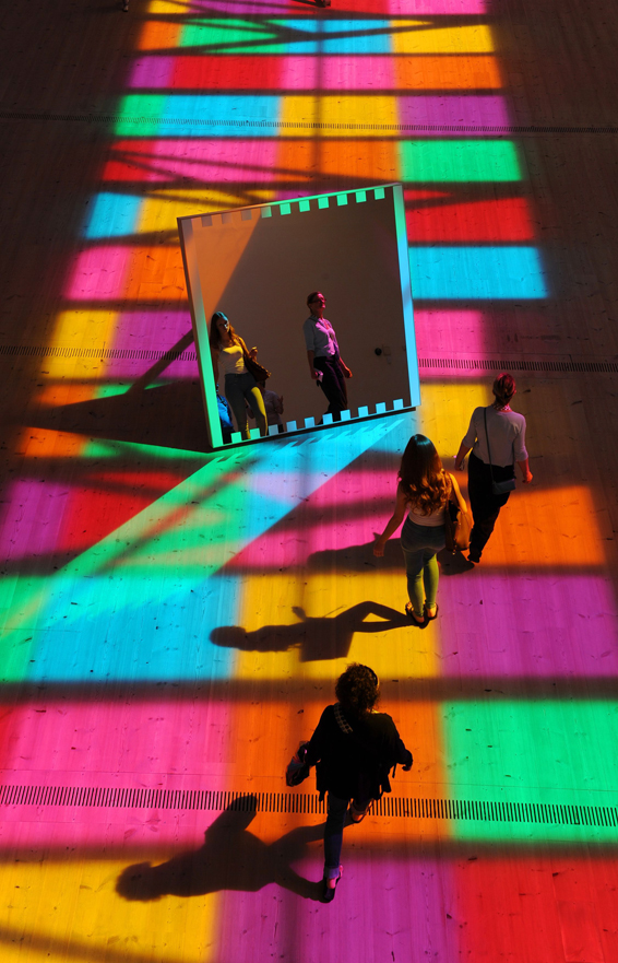 Daniel Buren's light show at the Baltic Arts centre in Gateshead...A light show by French artist Daniel Buren called Catch, which is on display at the Baltic Arts centre in Gateshead, the light is all natural sunlight which hits 10 mirrors with different coloured vinyl on a skylight. PRESS ASSOCIATION Photo. Picture date: Wednesday August 6, 2014. Photo credit should read: Owen Humphreys/PA Wire
