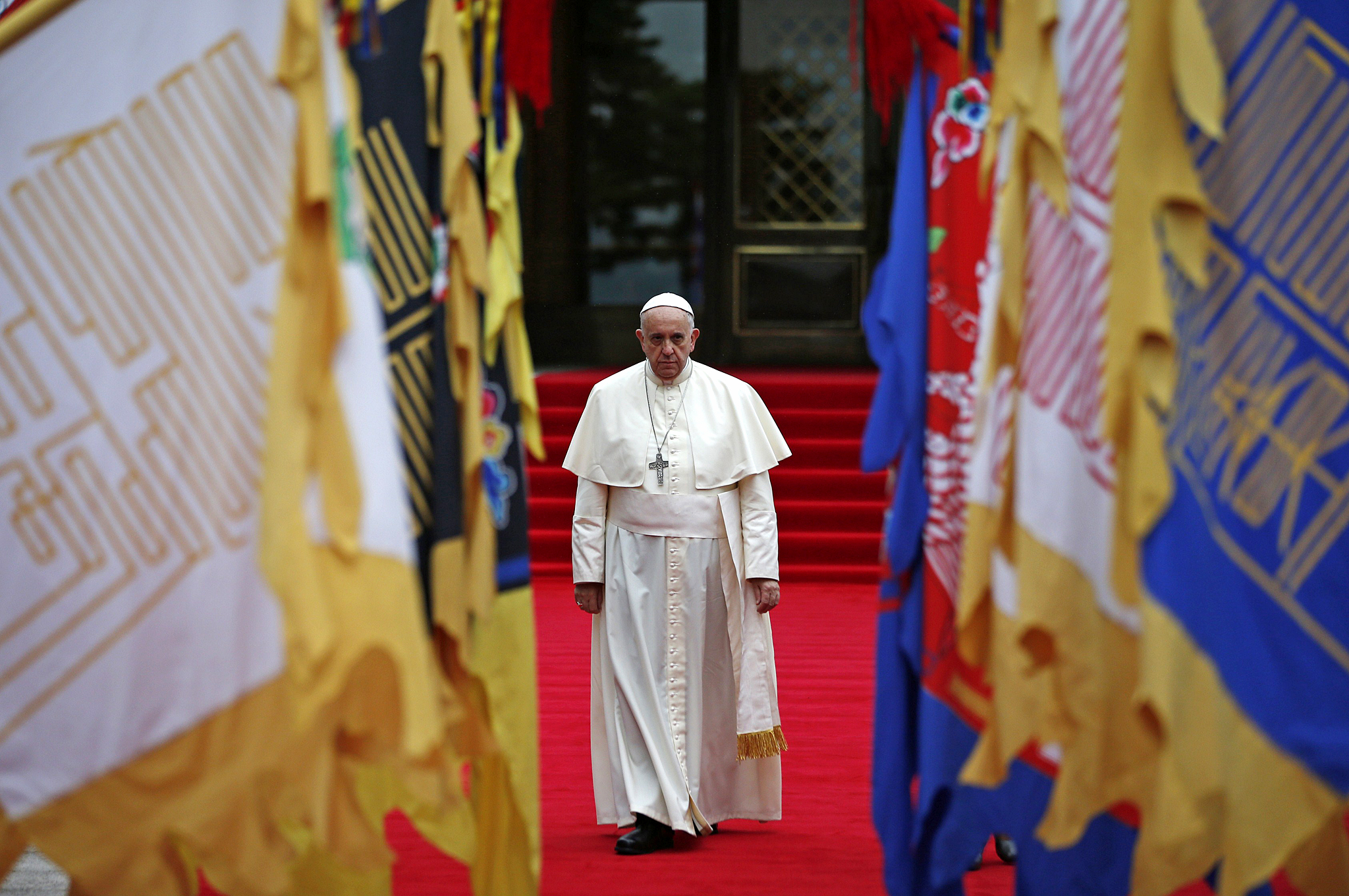 Pope Francis arrives to attend a welcomi...Pope Francis arrives to attend a welcoming ceremony at the presidential Blue House in Seoul on August 14, 2014. Pope Francis arrived in Seoul looking to fuel a new era of Catholic growth in Asia -- a mission fraught with complex political challenges but huge potential rewards. AFP PHOTO / POOL / Kim Hong-JiKim Hong-Ji/AFP/Getty Images