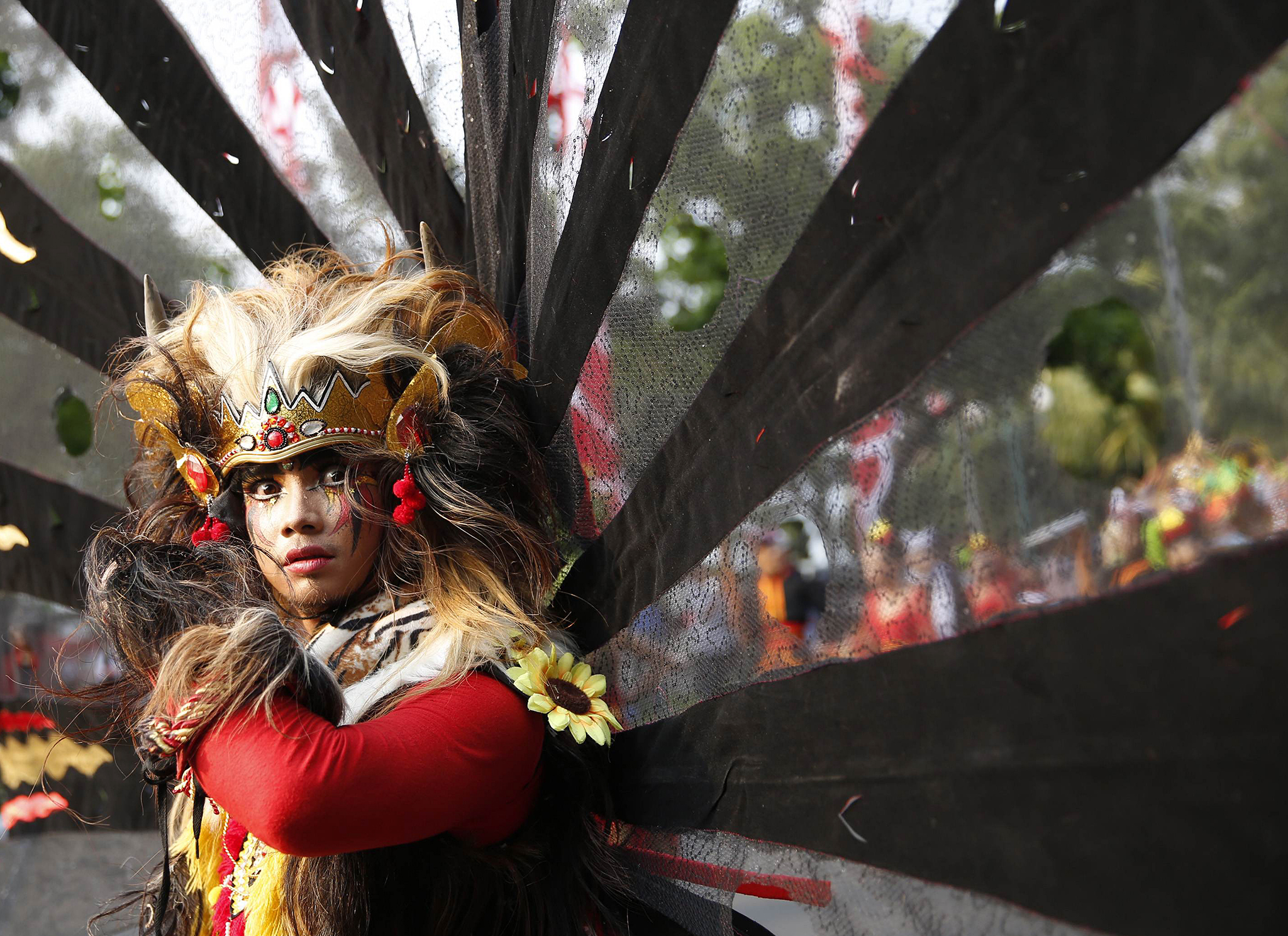 An Indonesian dancer waits for the start of a cultural parade marking the country's 69th Independence Day celebration in Jakarta...An Indonesian dancer waits for the start of a cultural parade marking the country's 69th Independence Day celebration in Jakarta August 18, 2014.