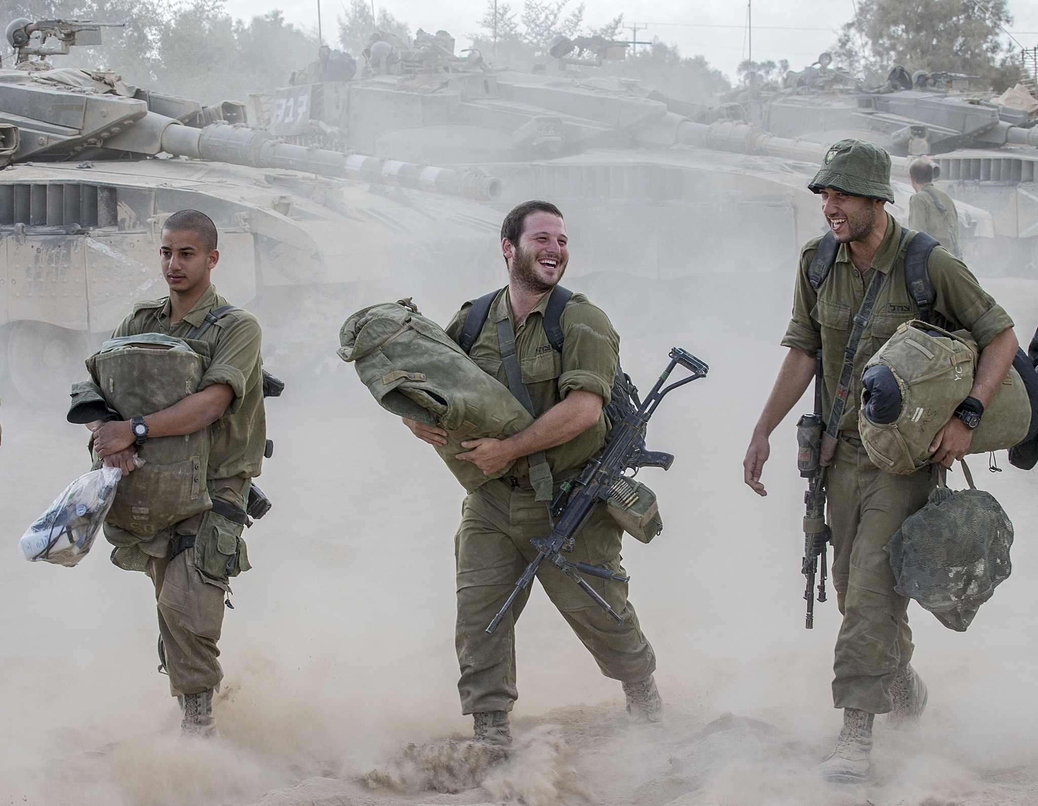Israeli soldiers make their to rest at a...Israeli soldiers make their to rest at an army deployment area near Israel's border with the Gaza Strip, on August 4, 2014. An eight-year-old girl was killed and 30 people wounded in a strike on the beachfront Shati refugee camp in Gaza City just minutes into an Israeli-declared truce, medics said.  AFP PHOTO / JACK GUEZJACK GUEZ/AFP/Getty Images