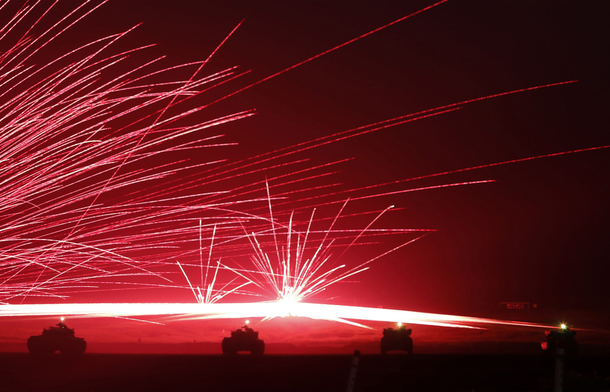 "REUTERS PICTURE HIGHLIGHT...ATTENTION EDITORS - REUTERS PICTURE HIGHLIGHT TRANSMITTED BY 1255 GMT ON AUGUST 19, 2014    GOT314  Tracer bullets ricochet off their targets as Japanese Ground Self-Defence Force tanks fire their machine guns during a night session of an annual training exercise at Higashifuji training field near Mount Fuji in Gotemba, west of Tokyo, August 19, 2014. REUTERS/Yuya Shino      REUTERS NEWS PICTURES HAS NOW MADE IT EASIER TO FIND THE BEST PHOTOS FROM THE MOST IMPORTANT STORIES AND TOP STANDALONES EACH DAY. Search for ""TPX"" in the IPTC Supplemental Category field or ""IMAGES OF THE DAY"" in the Caption field and you will find a selection of 80-100 of our daily Top Pictures."