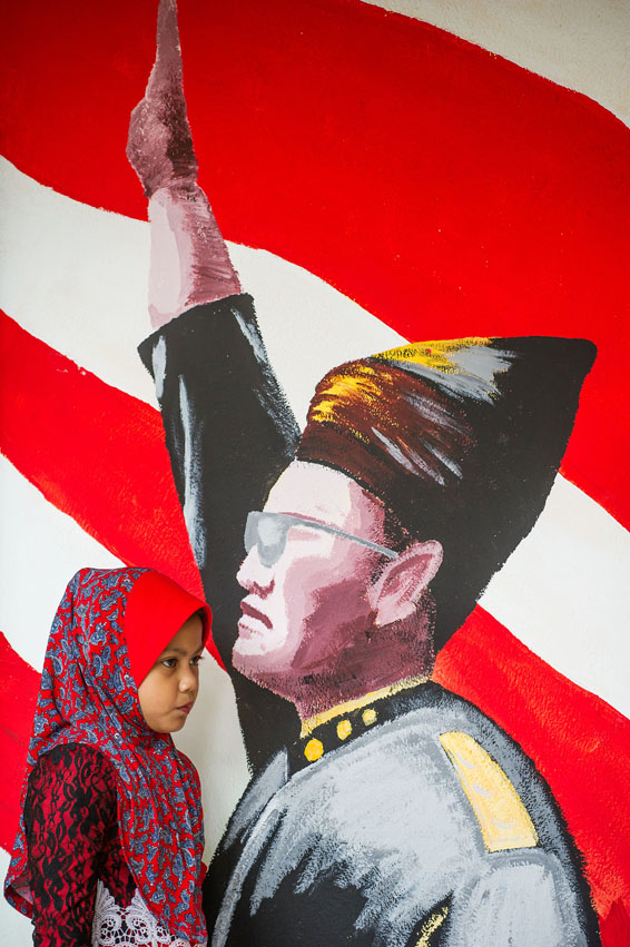 A Malaysian Muslim girl (L) walks near a...A Malaysian Muslim girl (L) walks near a painting of the country's first Prime Minister from independence in 1957, Tunku Abdul Rahman in Kuala Lumpur on August 26, 2014. Malaysia will marks its 57th National Day to commemorate the independence of the Federation of Malaya from British rule on August 31. AFP PHOTO / MOHD RASFANMOHD RASFAN/AFP/Getty Images