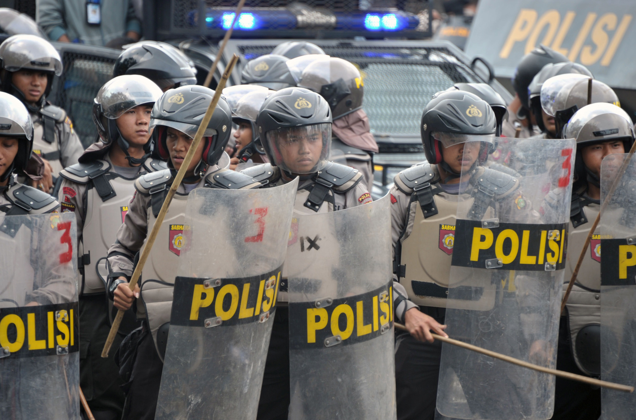Indonesian anti-riot police stand guard as presidential candidate Prabowo's supporters try to pass a blockade near the constitutional court in Jakarta. Indonesian ex-general Prabowo Subianto angrily claimed widespread cheating cost him victory in the country's presidential election at the start of legal challenge to the results.
