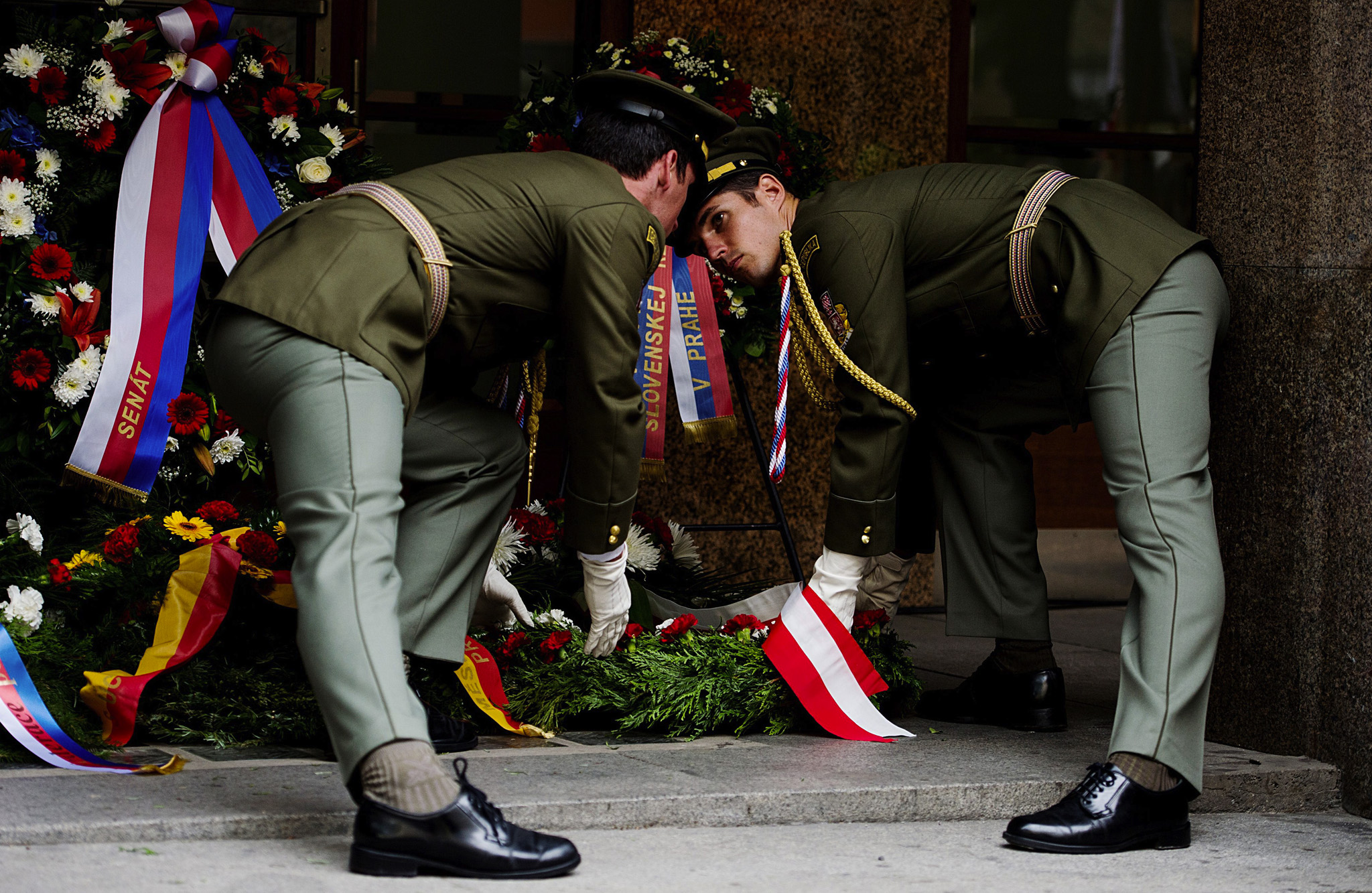 Czech Soldiers place a wreath during a ceremony outside the Czech Radio building in Prague to commemorate the 46th anniversary of the Soviet-led occupation of the former Czechoslovakia in 1968