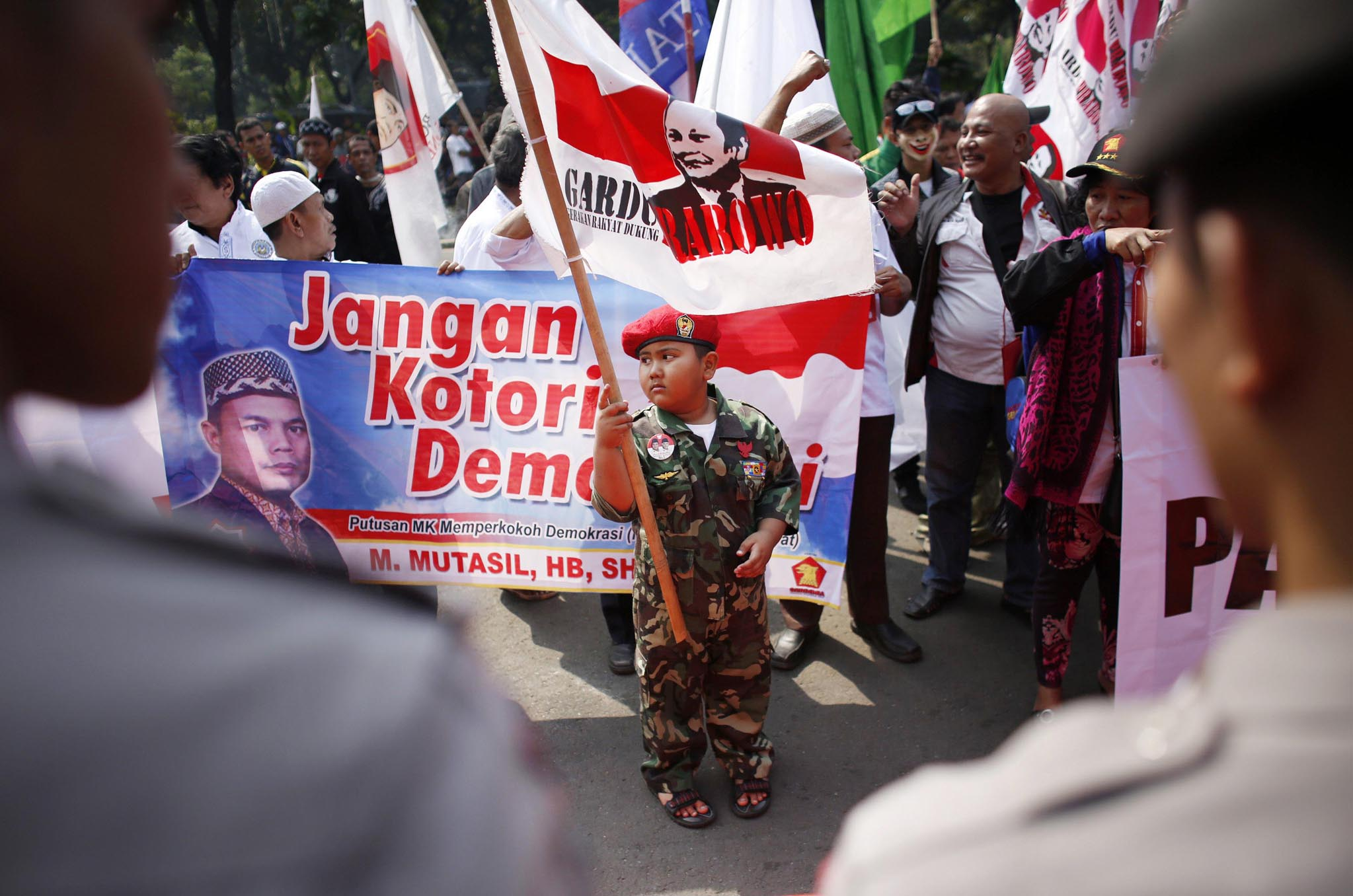 A boy takes part in a protest by supporters of losing presidential candidate Prabowo outside the Constitutional Court in Jakarta