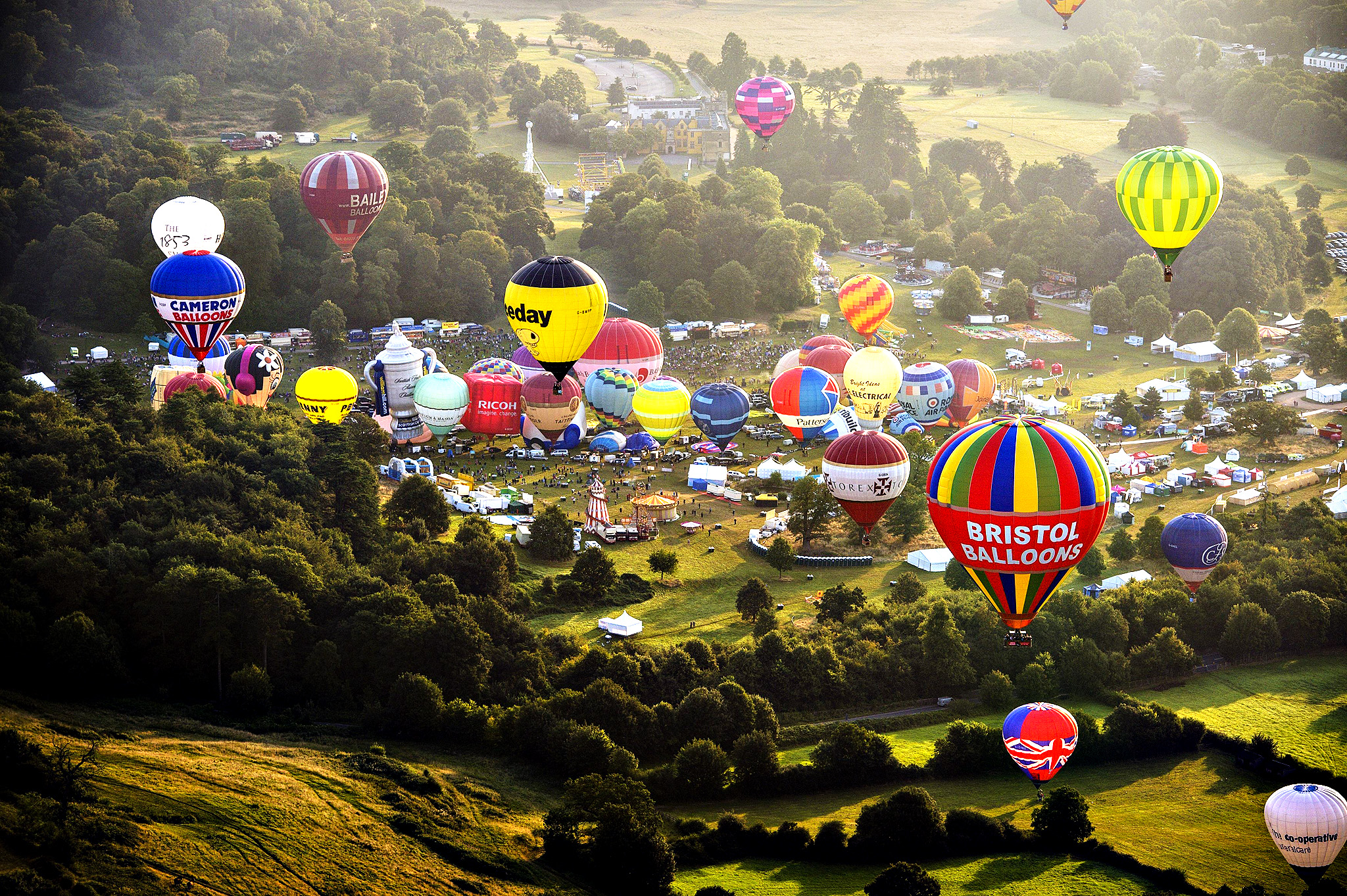 Hot air balloons lift off during a mass ascent at the 36th International Balloon Fiesta at the Ashton Court Estate near Bristol, which is Europe's largest ballooning event.