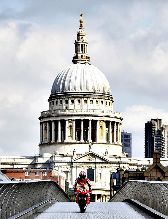 Honda MotoGP rider Marc Marquez of Spain poses on the Millennium Bridge with St Paul's Cathedral seen behind, in London, August 27, 2014. The British Grand Prix takes place at Silverstone on August 31.