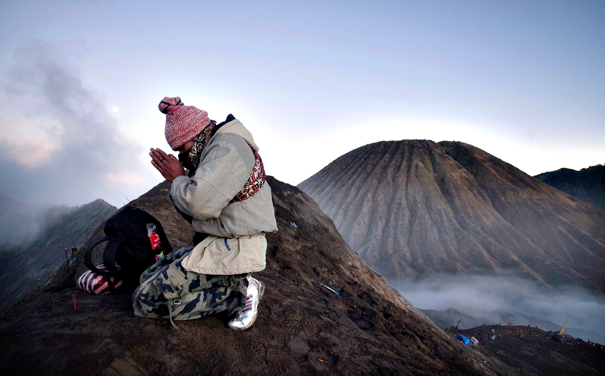 A Tengger tribesman prays at Mount Bromo during the annual Kasada ceremony in East Java onTuesday. The Kasada ceremony is a festival held every 14th day of the Kasada month in the traditional Hindu lunar calender to honour Sang Hyang Widhi (God Almighty) and is based on the legend of Roro Anteng and Joko Seger from the Majapahit Kingdom, from which their Tengger tribe name originates