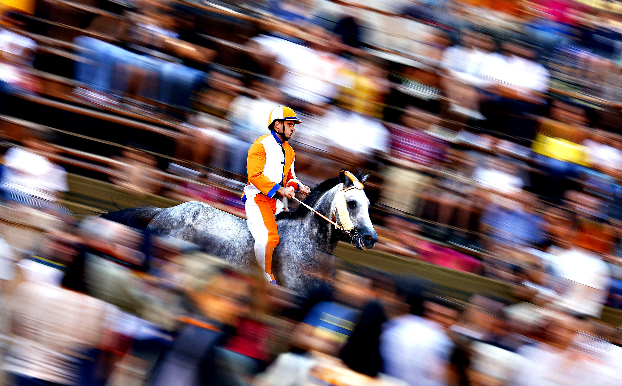 "Giuseppe Zedde of ""Leocorno"" or Unicorn parish rides his horse during the last day of practice for the Palio horse race in Siena...Giuseppe Zedde of ""Leocorno"" or Unicorn parish rides his horse during the last day of practice for the Palio horse race in Siena  August 15, 2014. Each July 2 and August 16, almost without fail since the mid-1600s, 10 riders have hurtled bareback around Siena's shell-shaped central square in a desperate bid to win the Palio, a silk banner depicting the Madonna and child."