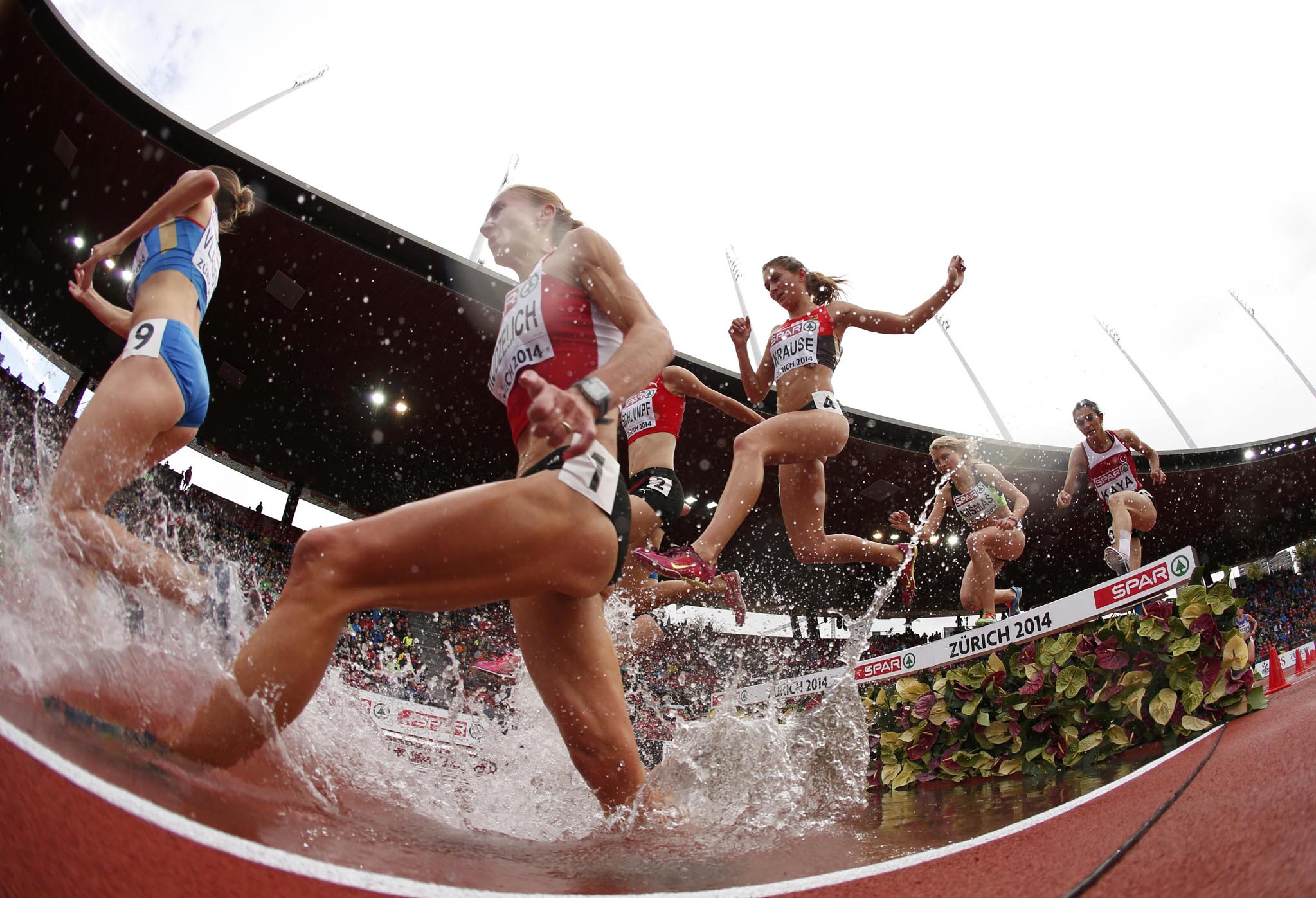 Kudzelich of Belarus Vlasova of Russia and Krause of Germany compete in women's 3000 metres steeplechase heat during European Athletics Championships in Zurich