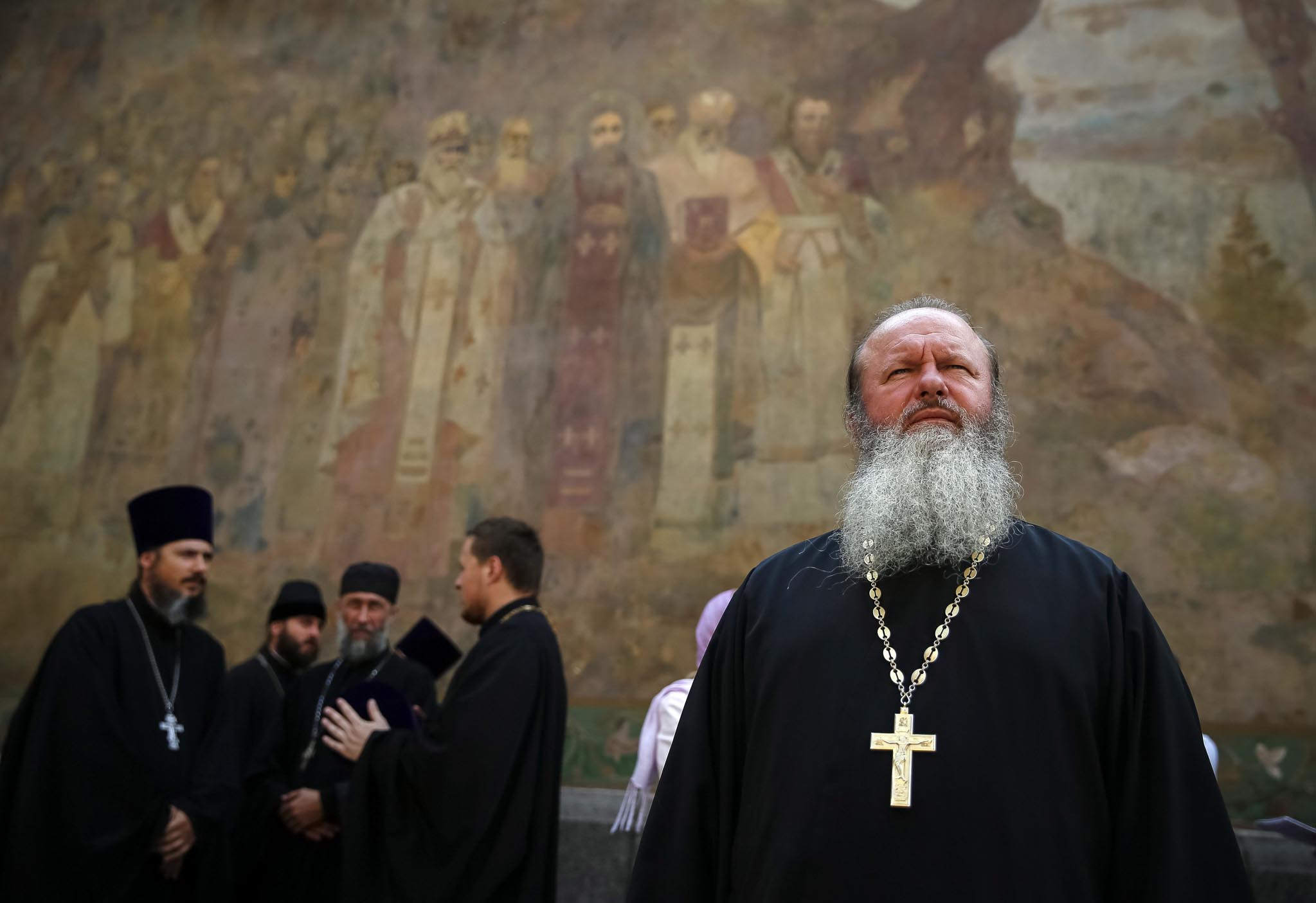 Clergymen attend a service near the Kiev Pechersk Lavra monastery on the day of the election of the Primate of the Ukrainian Orthodox Church of the Moscow Patriarchate, in Kiev August 13, 2014. Former Primate of the Ukrainian Orthodox Church of the Moscow Patriarchate, Metropolitan Vladimir of Kiev and All Ukraine died on July 5. REUTERS/Gleb Garanich (UKRAINE - Tags: RELIGION TPX IMAGES OF THE DAY)