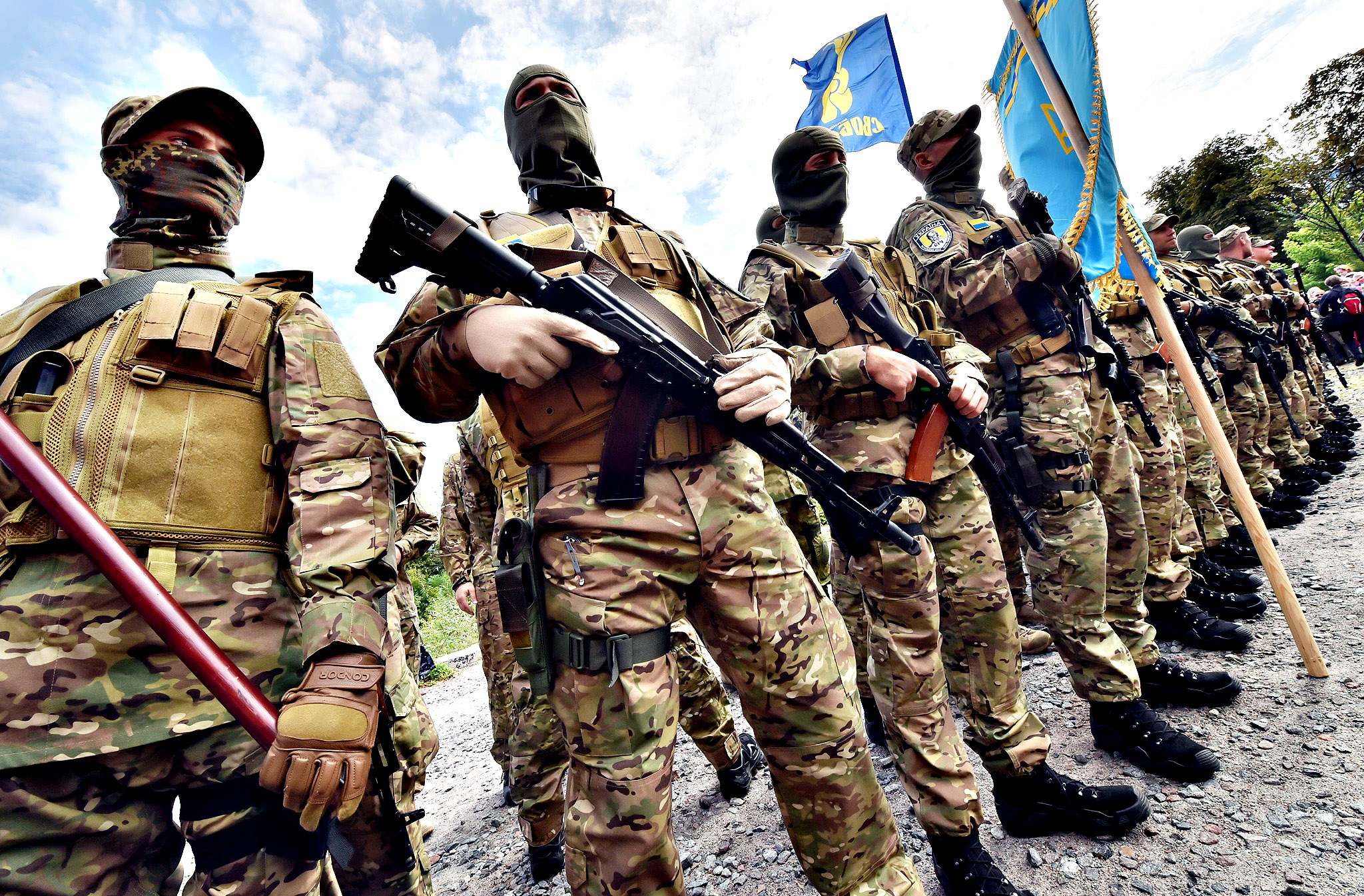 "Sich special volonteer battalion members stand on August 26, 2014 during an oath-taking and farewell ceremony in Kiev. The battalion is leaving the Ukrainian capital to take part in anti-terrorists operation (ATO) in the east of the country. Kiev's security services on August 26 released a video purporting to show captured 10 Russian soldiers captured on its territory who a Moscow military source claimed had crossed into Ukraine ""by accident."""