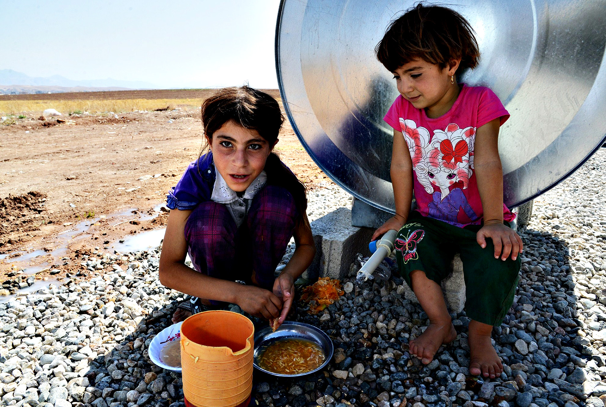 """Displaced Iraqi children from the Yazidi community are pictured in a refugee camp near the Turkey-Iraq border at Silopi in Sirnak on August 14, 2014.  The United States said Wednesday its troops found """"far fewer"""" Yazidi refugees marooned on a northern Iraqi mountain than expected, making an evacuation mission less likely, after air strikes pummeled besieging Islamic militants."""