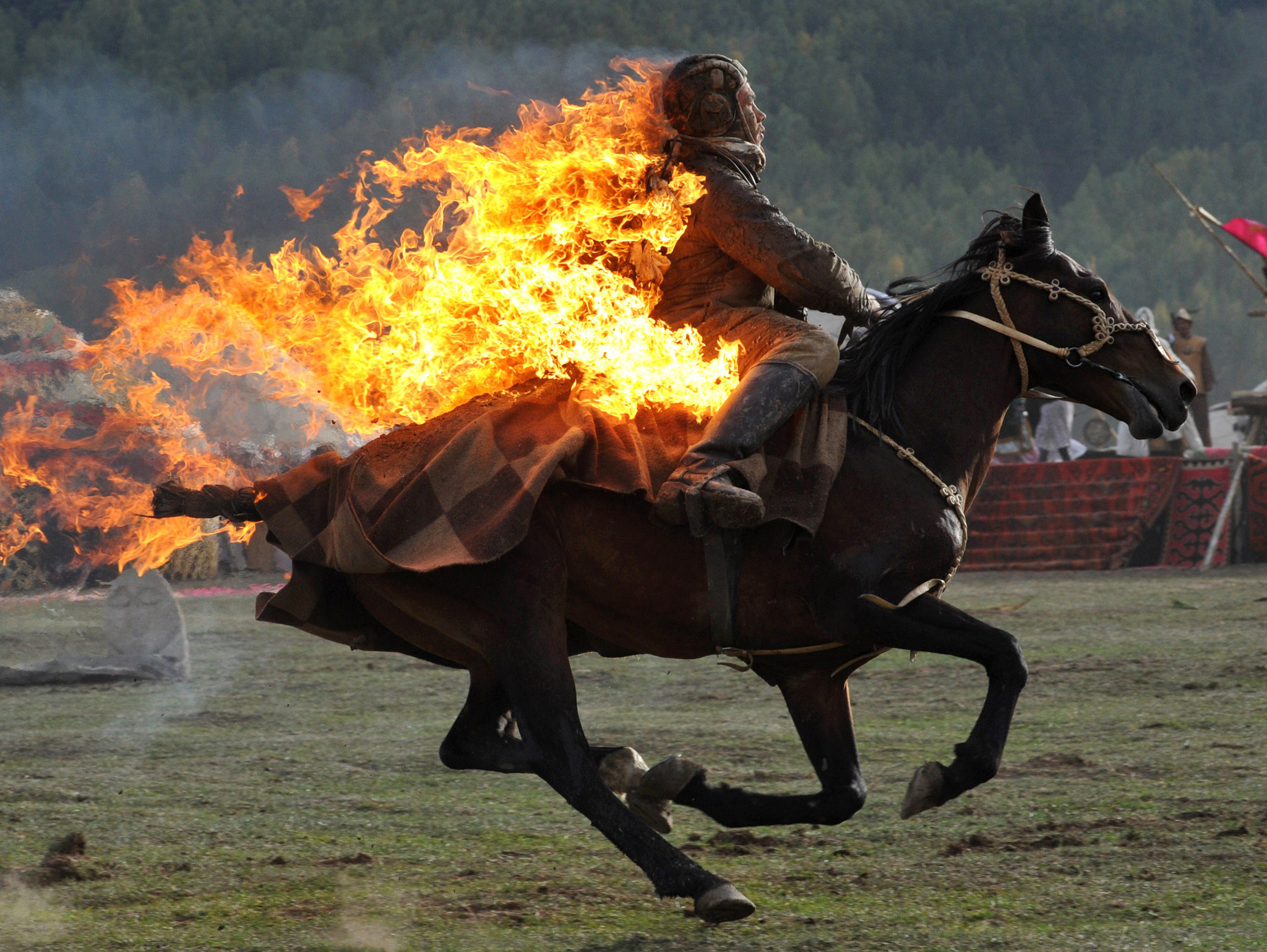 hoto taken on September 10, 2014 shows a Kyrgyz stuntman performing during the first World Nomad Games in the Kyrchin (Semenovskoe) gorge, some 300 km from Bishkek. Teams of Azerbaijan, Kazakhstan, Belarus, Mongolia and Tajikistan take part in the games. AFP PHOTO / VYACHESLAV OSELEDKOVYACHESLAV OSELEDKO/AFP/Getty Images