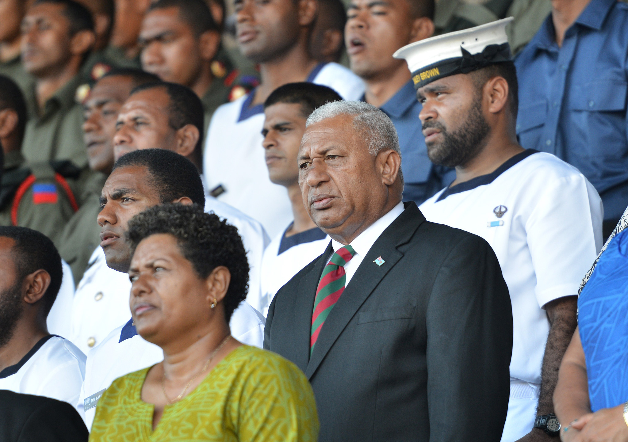 Fiji's military strongman Voreqe Bainima...Fiji's military strongman Voreqe Bainimarama (C) attends a national thanksgiving service for the release of the 45 Fijian peacekeepers kidnapped by Al-Qaeda linked Syrian rebels on the Golan Heights last month, at the ANZ Stadium in the capital Suva on September 16, 2014. Speaking at the service, Fiji President Epeli Nailatikau called for a violence-free election as the South pacific nation prepares to return to democracy almost eight years after a military coup. AFP PHOTO/Peter PARKSPETER PARKS/AFP/Getty Images