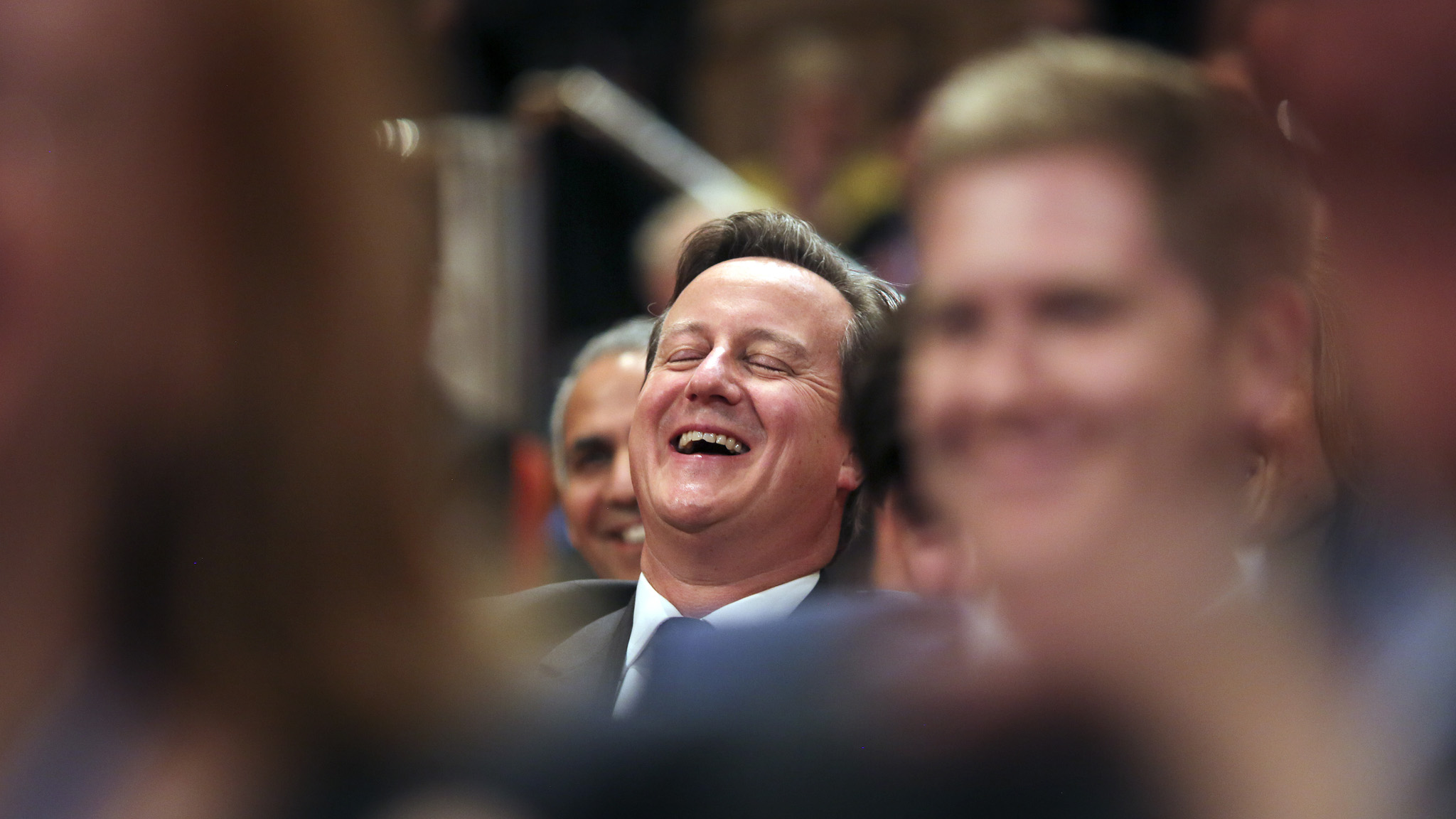 Prime Minster, David Cameron, laughs as Boris Johnson, London Mayor, delives his speech at the Conservative party conference in Birmingham this afternoon.