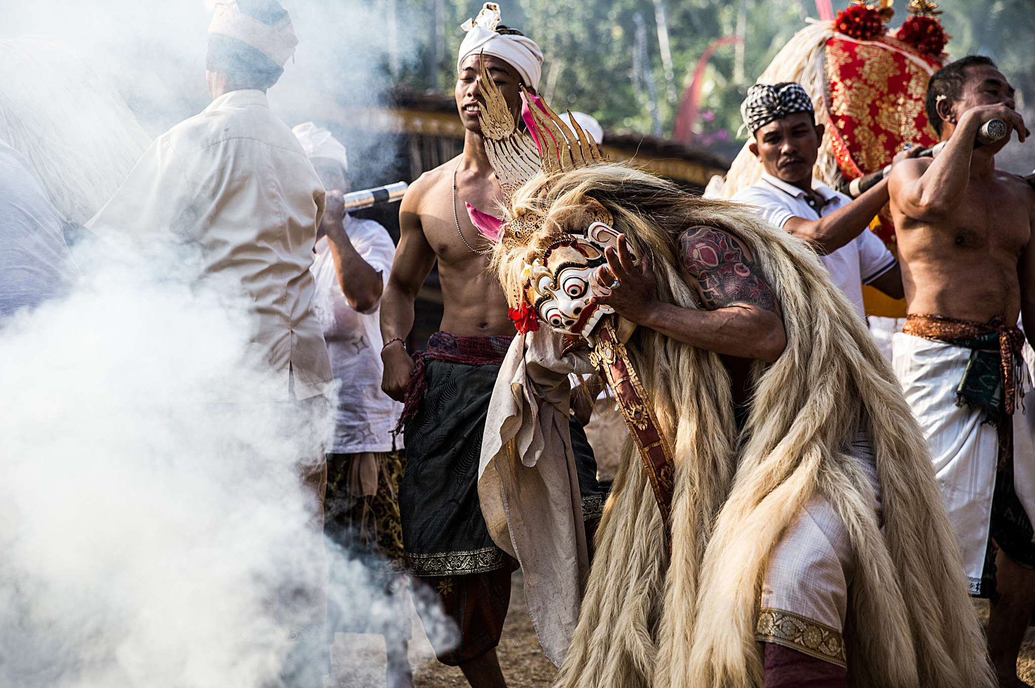 Balinese Villagers Celebrate The Annual Ngusaba Puseh Ritual...KARANGASEM, BALI, INDONESIA - SEPTEMBER 11: A Balinese man in a state of trance dances wearing a sacred Rangda mask during a sacred ritual of Ngusaba Puseh at Selumbung Village on September 11, 2014 in the Karangasem District, Bali, Indonesia. The Ngusaba Puseh  ritual is performed once a year to celebrate the ancestors of the local community and show gratitude to God.  (Photo by Agung Parameswara/Getty Images)