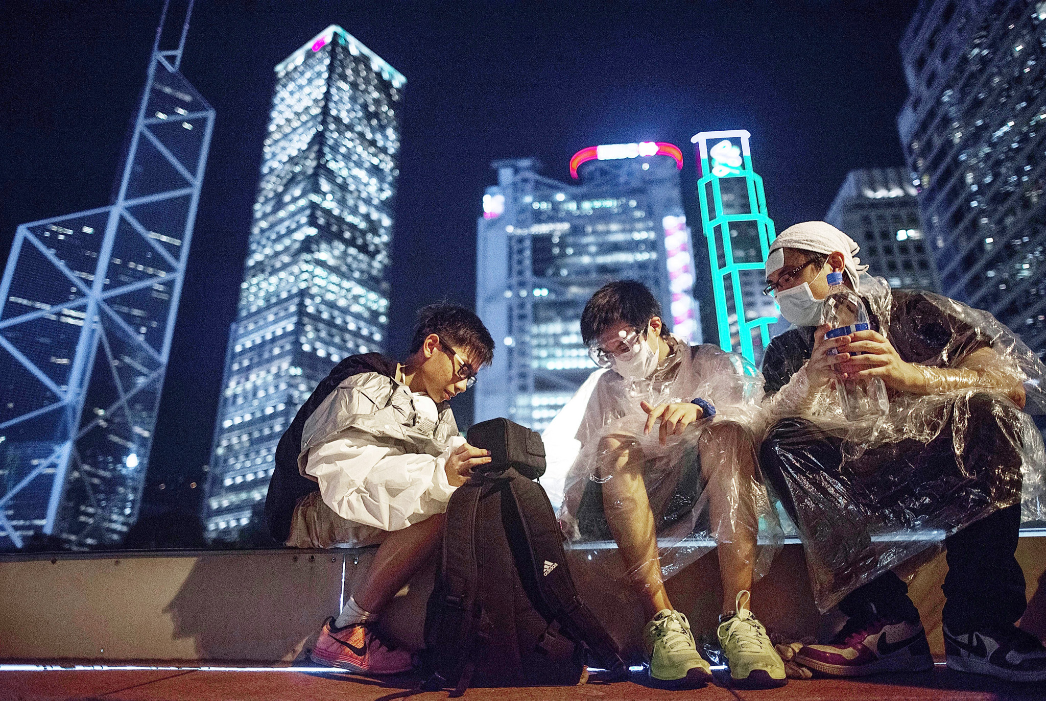 Pro Democracy Supporters Attempt To Bring Hong Kong To A Stand Still With Mass Rally...HONG KONG - SEPTEMBER 29:  Protesters sit on top of a parking ramp in the Central District on September 29, 2014 in Hong Kong. Thousands of pro democracy supporters have remained in the streets of Hong Kong for another day of protests. Protestors are unhappy with Chinese government's plans to vet candidates in Hong Kong's 2017 elections.  (Photo by Anthony Kwan/Getty Images)