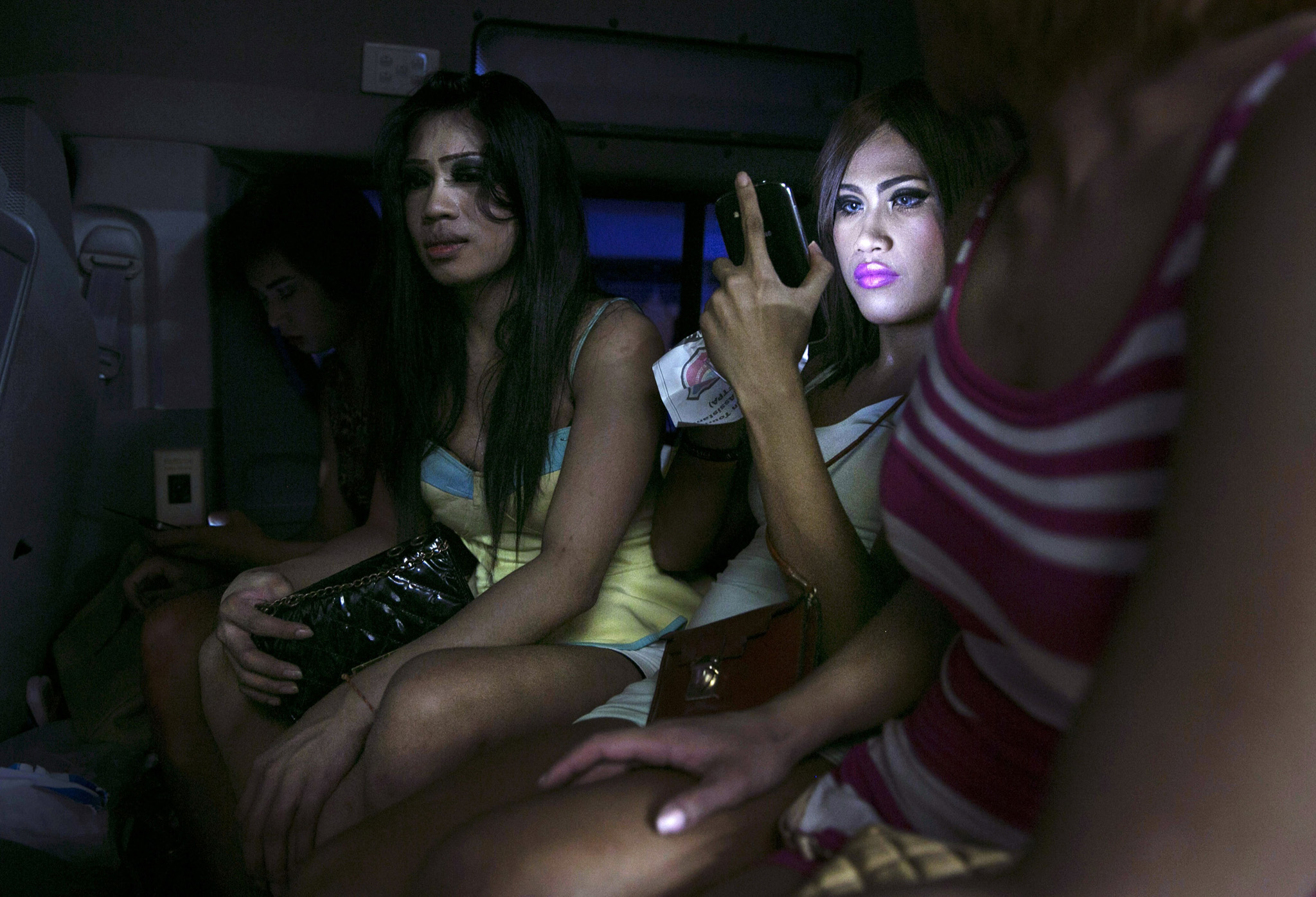***BESTPIX***Crime Reduction Campaign In Pattaya Clamps Down On Thai Ladyboys...PATTAYA, THAILAND - SEPTEMBER 21: Thai ladyboys are detained inside a police van on their way to the police station September 21, 2014 in Pattaya, Thailand. Pattaya is tackling sex tourism and crime as the city attempts to clean up it's image doing nightly sweeps in the popular red-light district called the Walking Street. Ladyboy sex workers are being targeted by police who are assisted by members of the Foreign Tourist Police Assistants (FTPA). They are fined 300 Thai bhat ( almost $10 US). (Photo by Paula Bronstein/Getty Images)***BESTPIX***