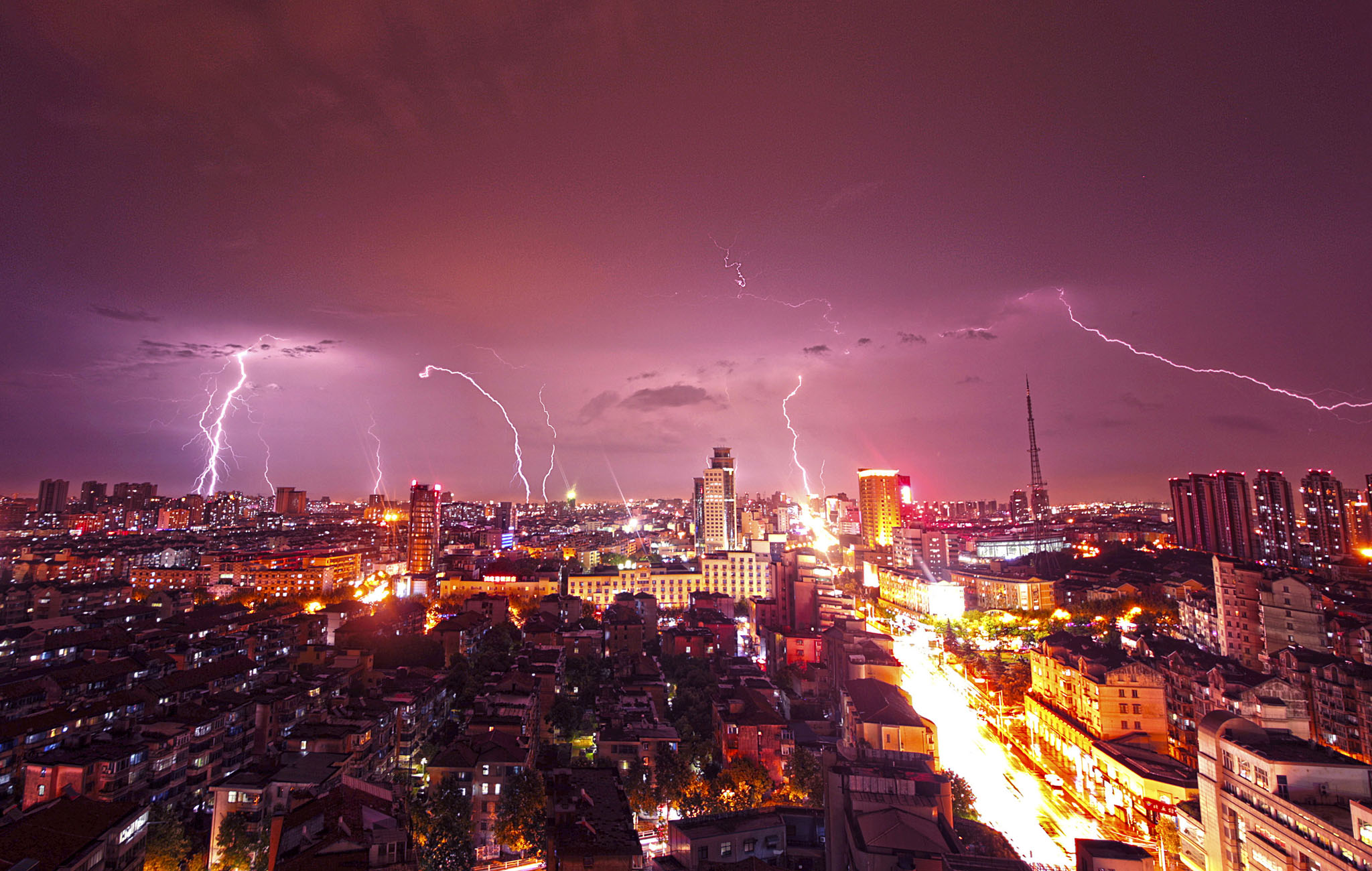 Lightning strikes over buildings during heavy rainfall in Kunshan, Jiangsu province, September 2, 2014.