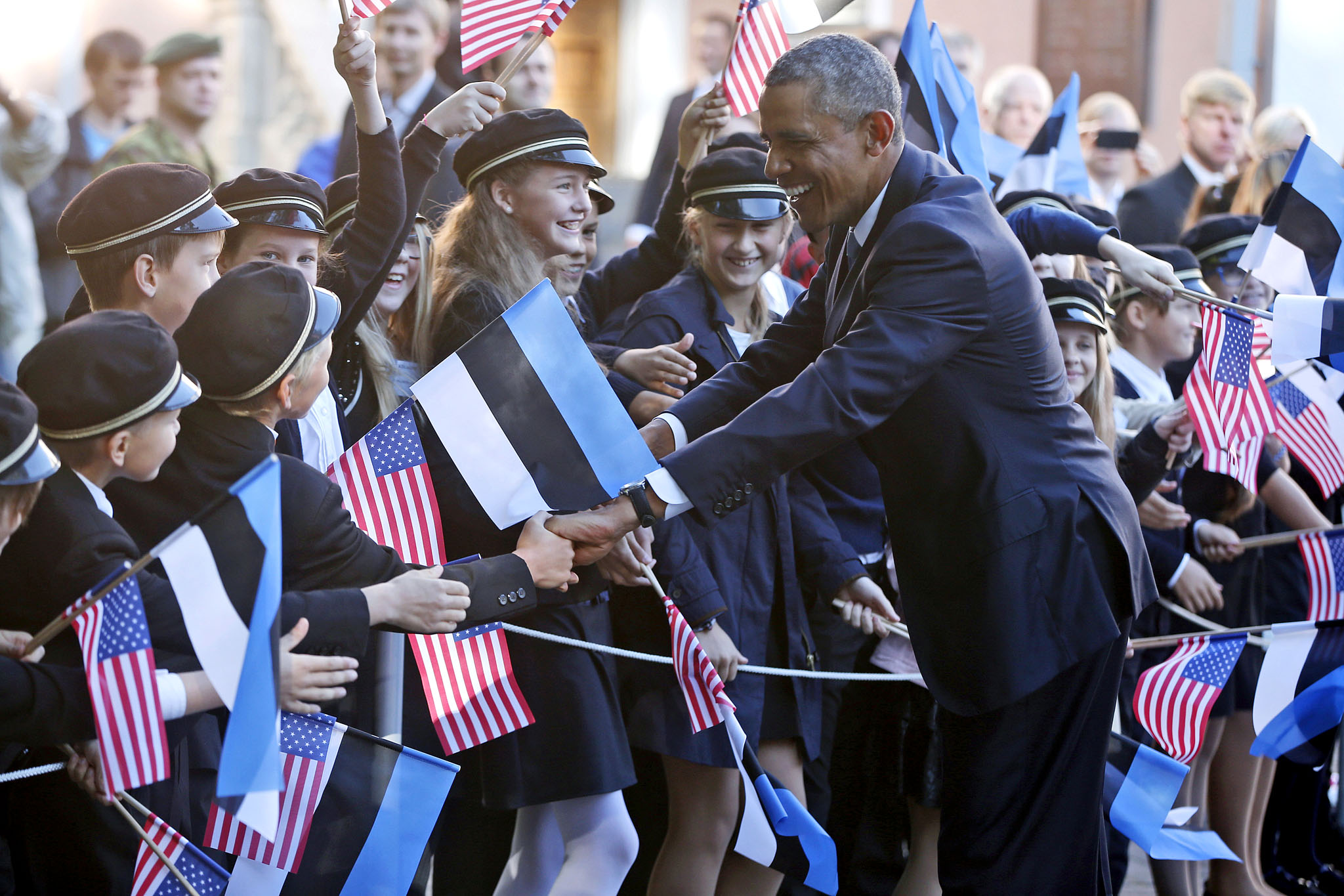 Barack Obama...U.S. President Barack Obama greets children as he is welcomed by Estonian President Toomas Hendrik Ilves at Kadriorg Palace in Tallinn, Estonia, Wednesday, Sept. 3, 2014. Obama is in Estonia for a one day visit where he will meet with Baltic State leaders before heading to the NATO Summit in Wales. (AP Photo/Charles Dharapak)