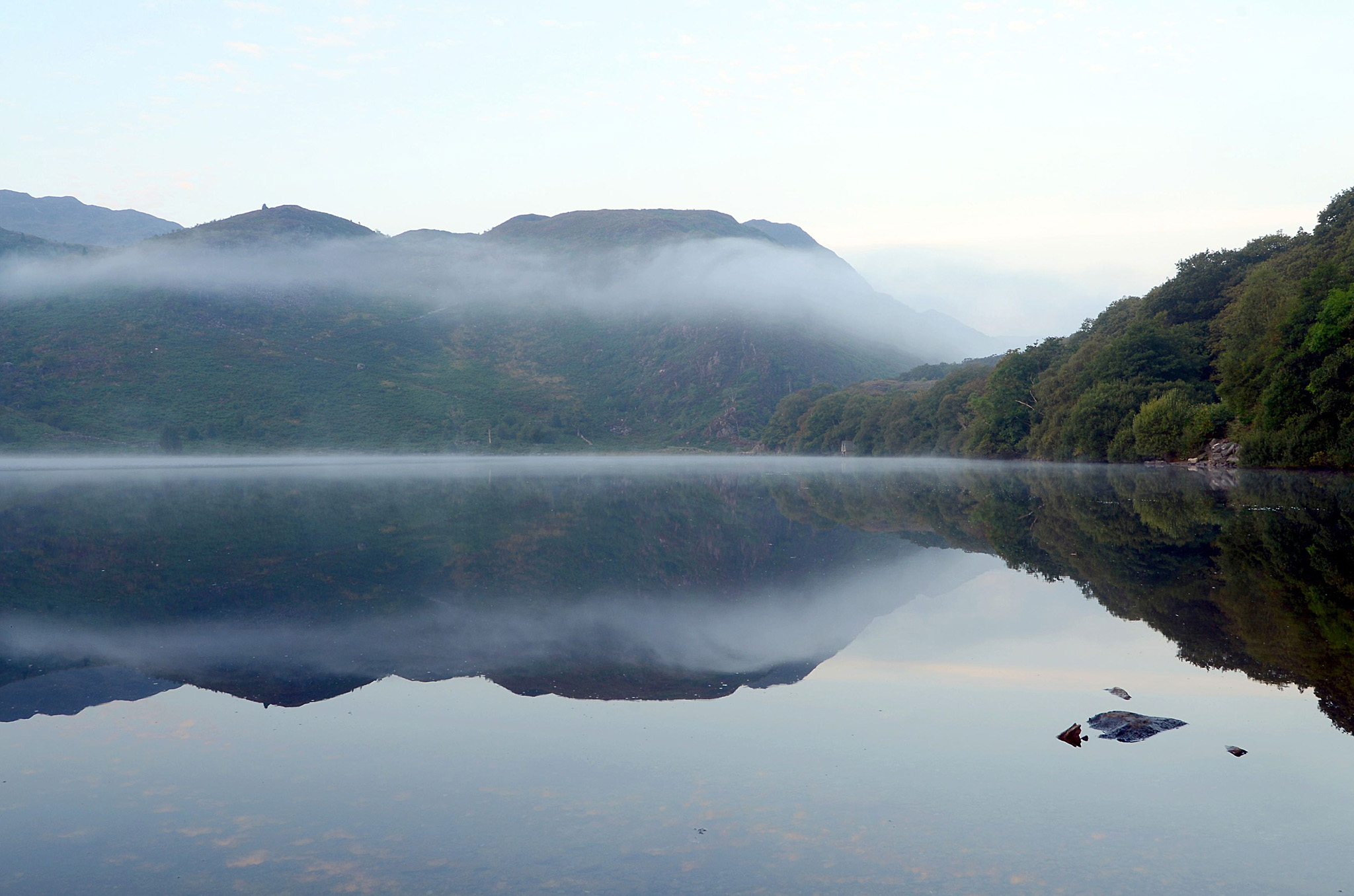 Autumn weather Sept 10th 2014...A general view of the sunrise over Llyn Dinas, near Beddgelert, Snowdonia, North Wales. PRESS ASSOCIATION Photo. Picture date: Wednesday September 10, 2014. Photo credit should read: Neil Squires/PA Wire