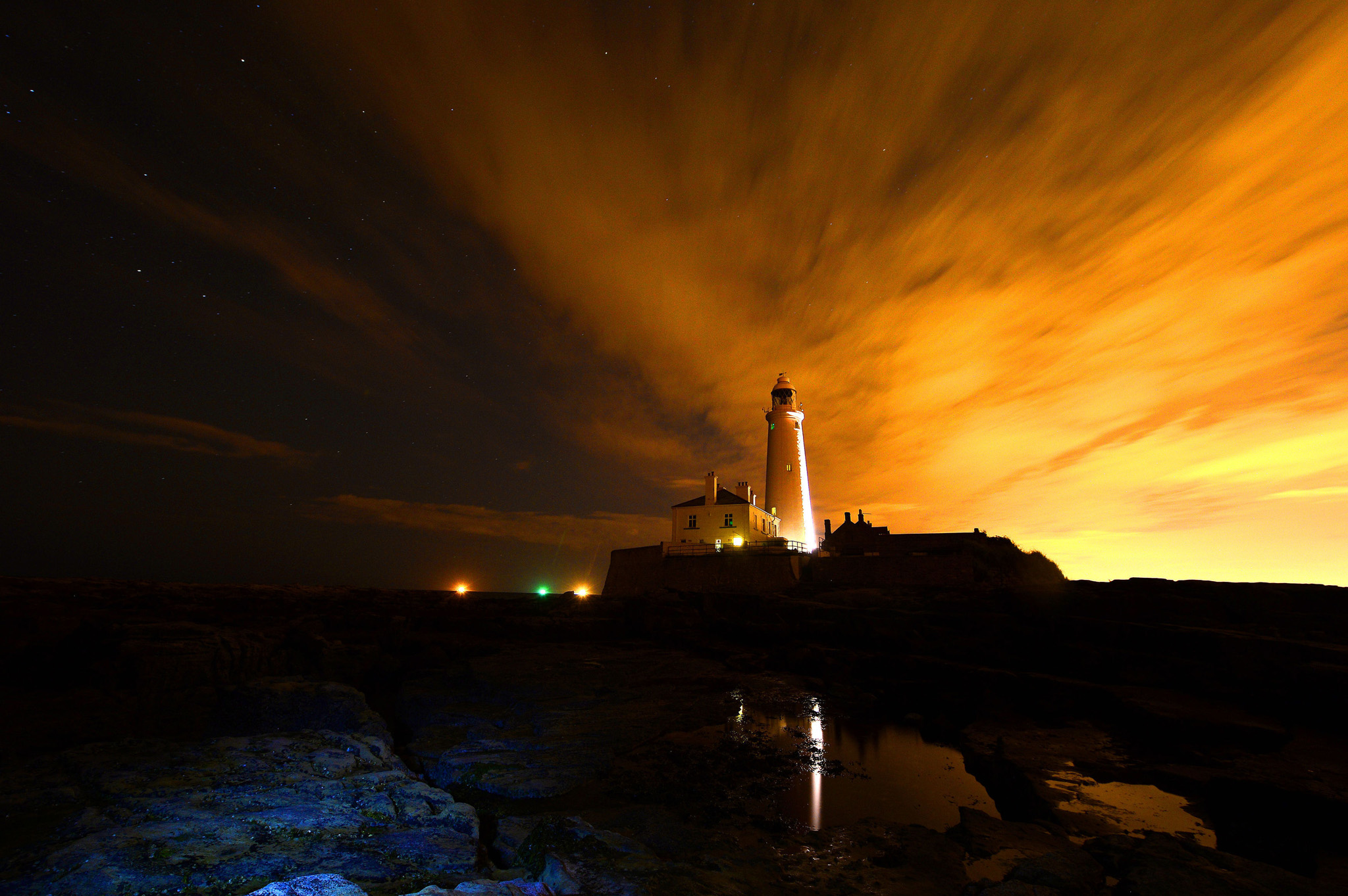 St Mary's Lighthouse - Tyne & Wear...File photo dated 14/08/14 using a time-exposure, of a night sky over St Mary's Lighthouse on St Maryís Island, Whitley Bay, Tyne & Wear. PRESS ASSOCIATION Photo. Issue date: Monday September 22, 2014. Press Association photographer Owen Humphreys, has been photographing the changing weather patterns over St Mary's, near to his home, for the last 18 months, capturing the different 'moods', from sunrises to sunsets, storms and even auroras. The Lighthouse, completed in 1898 on a hazardous coast for shipping, remained operational until 1984 when it was superseded by modern navigational techniques. Since then the Lighthouse and former keepers' cottages have been operated as a visitor centre by North Tyneside Council. The surrounding Nature Reserve contains an area of rockpools, clifftop grassland, a beach and newly created wetland habitats and attracts thousands of visitors each year. Photo credit should read: Owen Humphreys/PA Wire