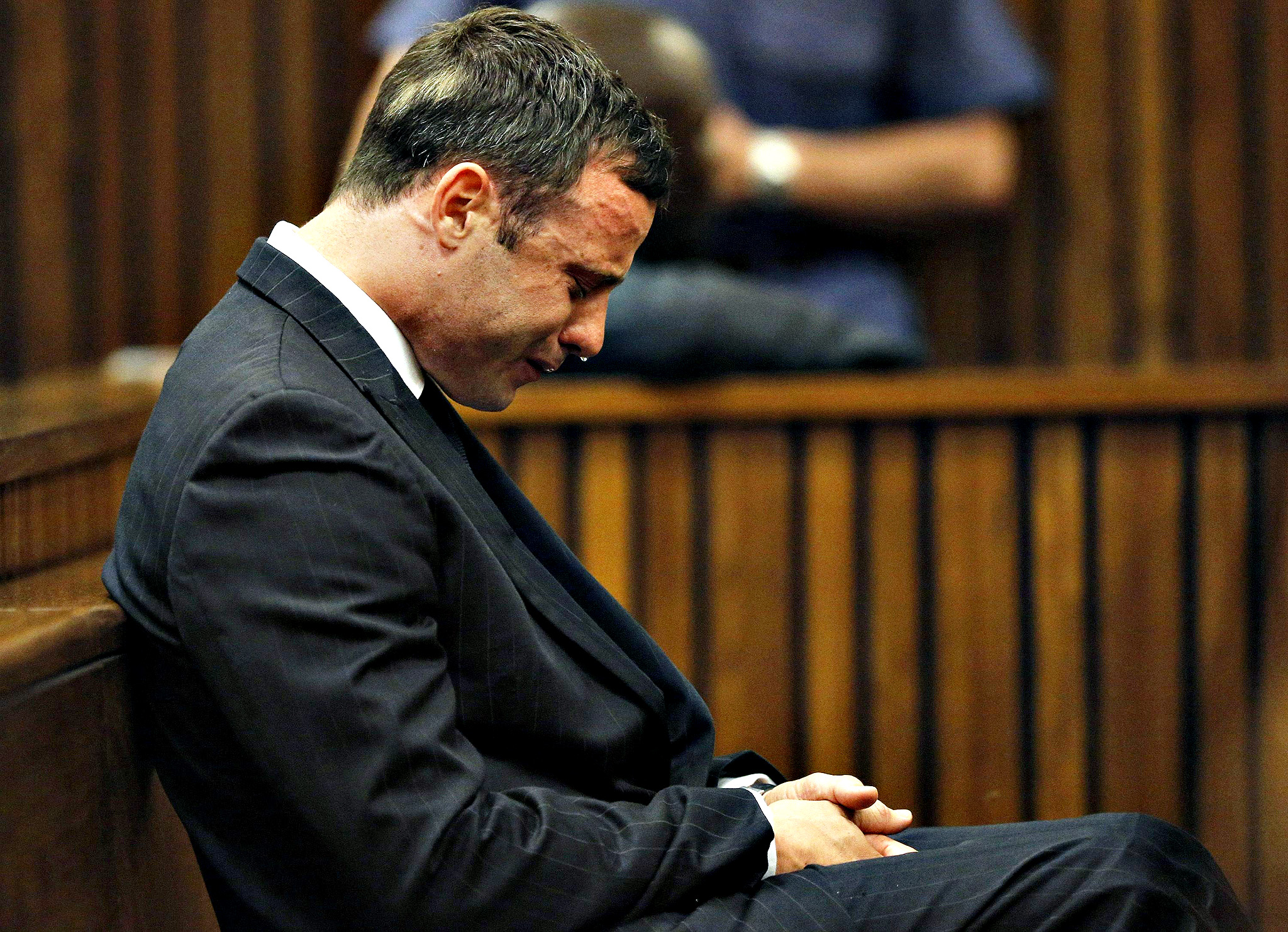 Olympic and Paralympic track star Oscar Pistorius reacts as he listens to Judge Thokozile Masipa's judgement at the North Gauteng High Court in Pretoria...Olympic and Paralympic track star Oscar Pistorius reacts as he listens to Judge Thokozile Masipa's judgement at the North Gauteng High Court in Pretoria, September 11, 2014. A South African judge cleared Oscar Pistorius of all murder charges on Thursday, saying prosecutors had failed to prove the Olympic and Paralympic track star intended to kill his girlfriend or an imagined intruder on Valentine's Day last year.