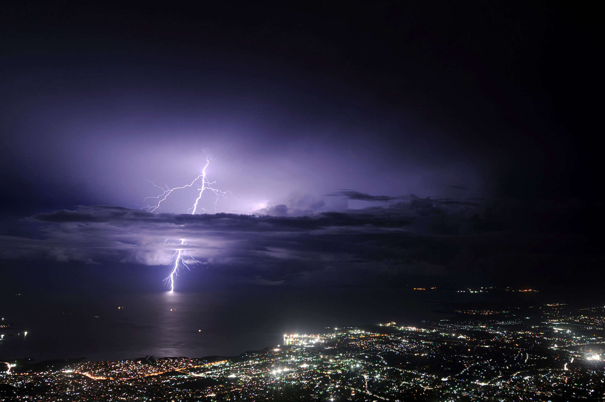 Lightning strikes over the sea along the...Lightning strikes over the sea along the coast of the Haitian capital, Port au Prince,  during an evening thunderstorm on September 24, 2014