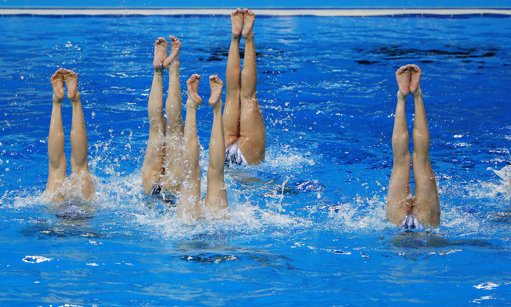 North Korea's synchronised swimming team take part in a practice session at Munhak Park Tae-hwan Aquatics Center ahead of the 17th Asian Games in Incheon...North Korea's synchronised swimming team take part in a practice session at Munhak Park Tae-hwan Aquatics Center ahead of the 17th Asian Games in Incheon September 17, 2014. The 17th Asian Games run from September 19 to October 4.    REUTERS/Kim Kyung-Hoon (SOUTH KOREA - Tags: SPORT SWIMMING)