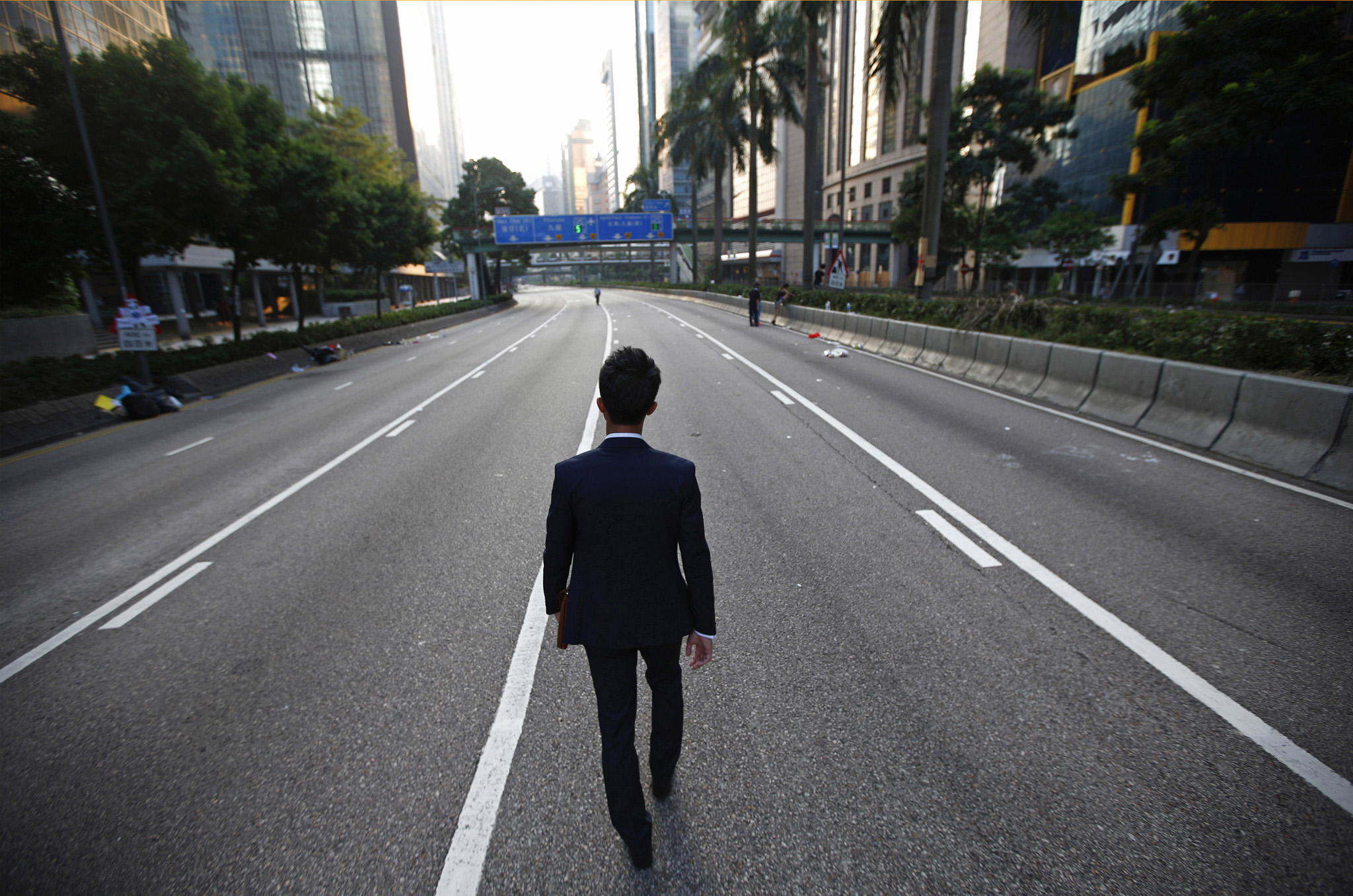 "REUTERS PICTURE HIGHLIGHT...ATTENTION EDITORS - REUTERS PICTURE HIGHLIGHT TRANSMITTED BY 0540 GMT ON SEPTEMBER 30, 2014    CB02  A man walks along an empty street near the central financial district in Hong Kong September 30, 2014. REUTERS/Carlos Barria    REUTERS NEWS PICTURES HAS NOW MADE IT EASIER TO FIND THE BEST PHOTOS FROM THE MOST IMPORTANT STORIES AND TOP STANDALONES EACH DAY. Search for ""TPX"" in the IPTC Supplemental Category field or ""IMAGES OF THE DAY"" in the Caption field and you will find a selection of 80-100 of our daily Top Pictures.    REUTERS NEWS PICTURES.     TEMPLATE OUT"