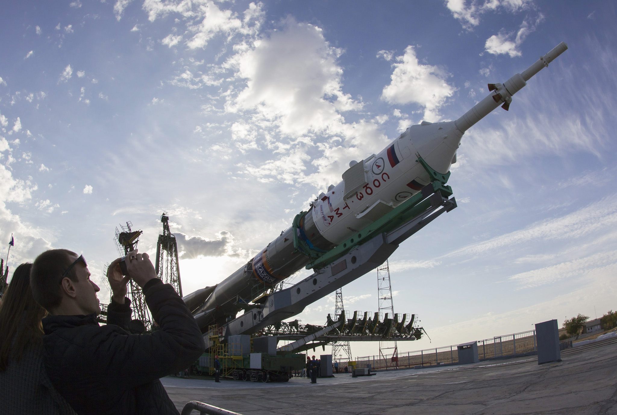 A man takes a photo of the Soyuz TMA-14M spacecraft as it is lifted to its launch pad at Baikonur cosmodrome...A man takes a photo of the Soyuz TMA-14M spacecraft as it is lifted to its launch pad at Baikonur cosmodrome September 23, 2014. The Soyuz is scheduled to carry Barry Wilmore of the U.S., Elena Serova and Alexander Samokutyaev of Russia to the International Space Station on September 26. REUTERS/Shamil Zhumatov (KAZAKHSTAN - Tags: SCIENCE TECHNOLOGY)