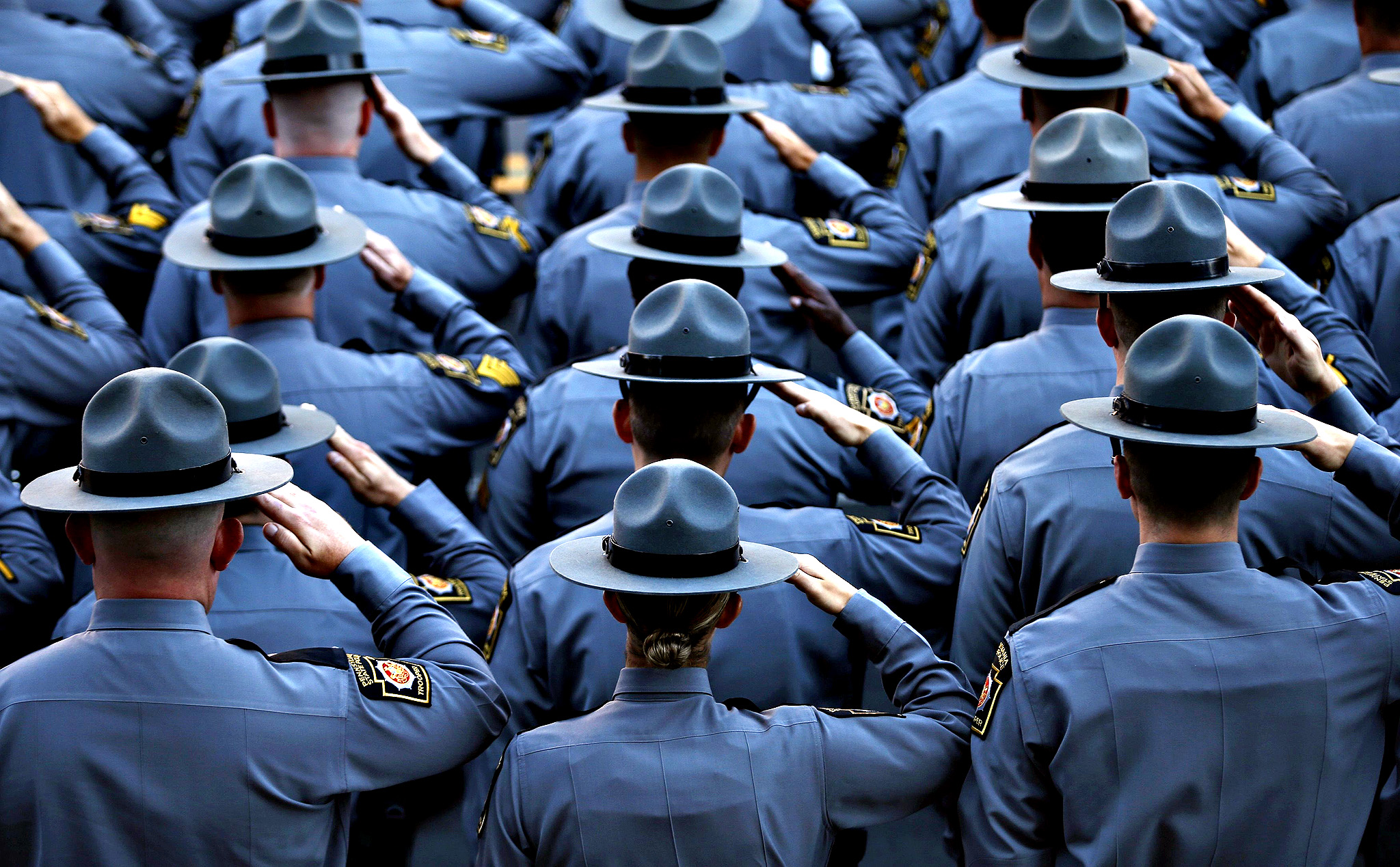 Pennsylvania State Police salute as they line the streets outside St. Peters' Cathedral in Scranton, as the casket carrying slain Pennsylvania State Police Trooper Corporal Bryon Dickson is carried into the Cathedral for his funeral service...Pennsylvania State Police salute as they line the streets outside St. Peters' Cathedral in Scranton, Pennsylvania September 18, 2014, as the casket carrying slain Pennsylvania State Police Trooper Corporal Bryon Dickson, 38 is carried into the Cathedral for his funeral service. The survivalist suspected of the ambush attack last week that killed Dickson and seriously wounded another is a member of a Cold War re-enactment group, state police said on Wednesday.