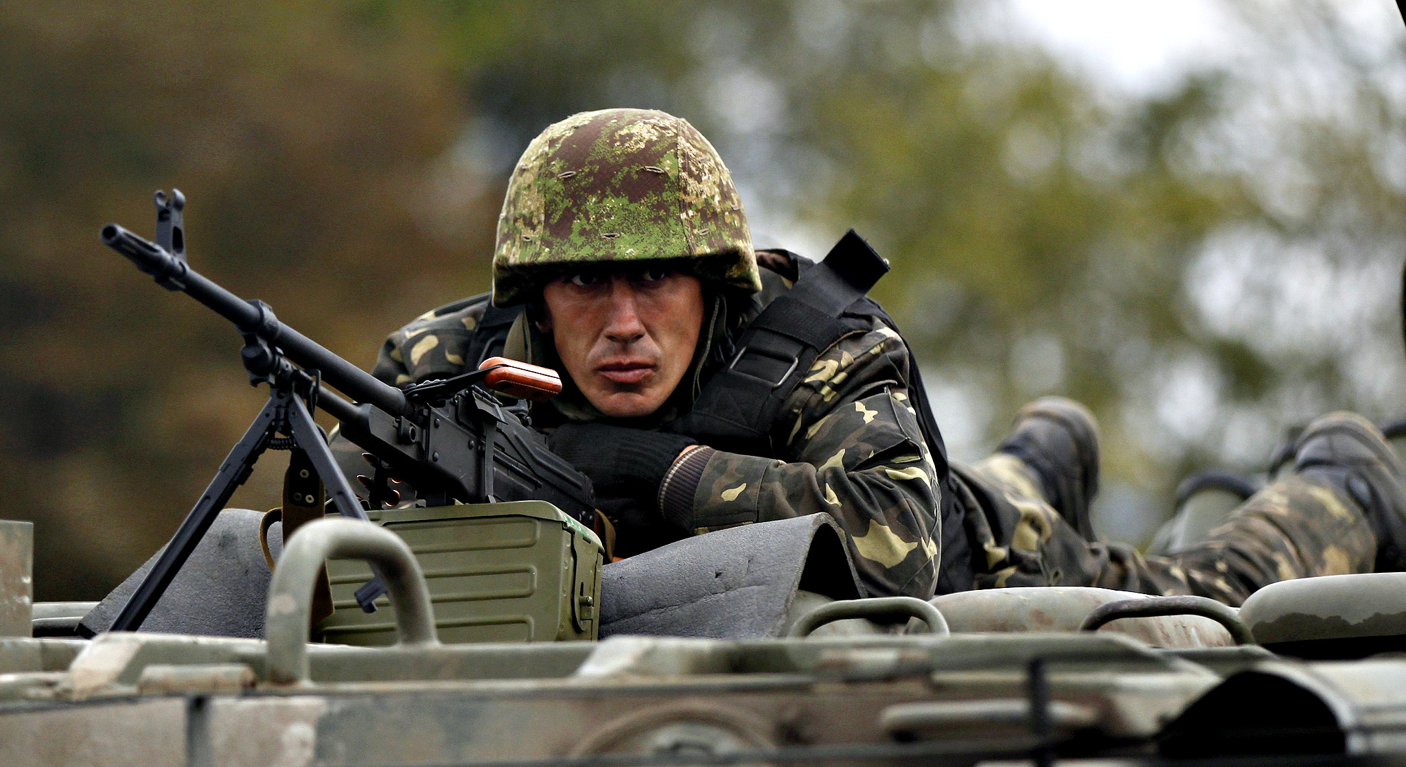 A Ukrainian serviceman rides on an armoured vehicle near the eastern Ukrainian town of Debaltseve, September 23, 2014.