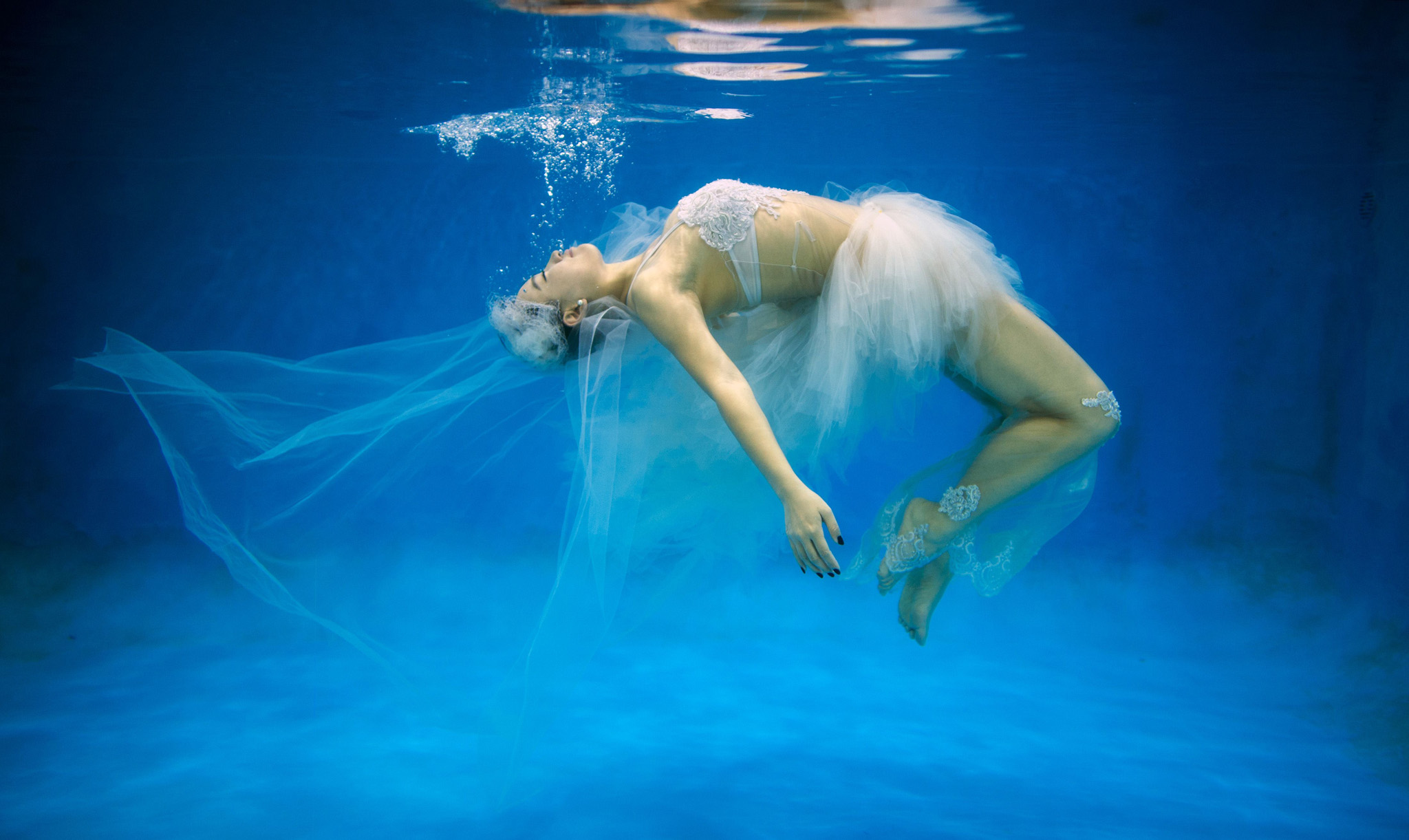 TOPSHOTS This photo taken on September 3...TOPSHOTS This photo taken on September 3, 2014 shows  Leng Yuting, 26, posing underwater for her wedding pictures at a photo studio in Shanghai, ahead of her wedding next year. Her fiance Riyang said they had their wedding photographs taken underwater because 'its romantic and beautiful'. Mr Wedding studio owner, Tina Lui, started providing underwater pictures four years ago.   AFP PHOTO / JOHANNES EISELEJOHANNES EISELE/AFP/Getty Images