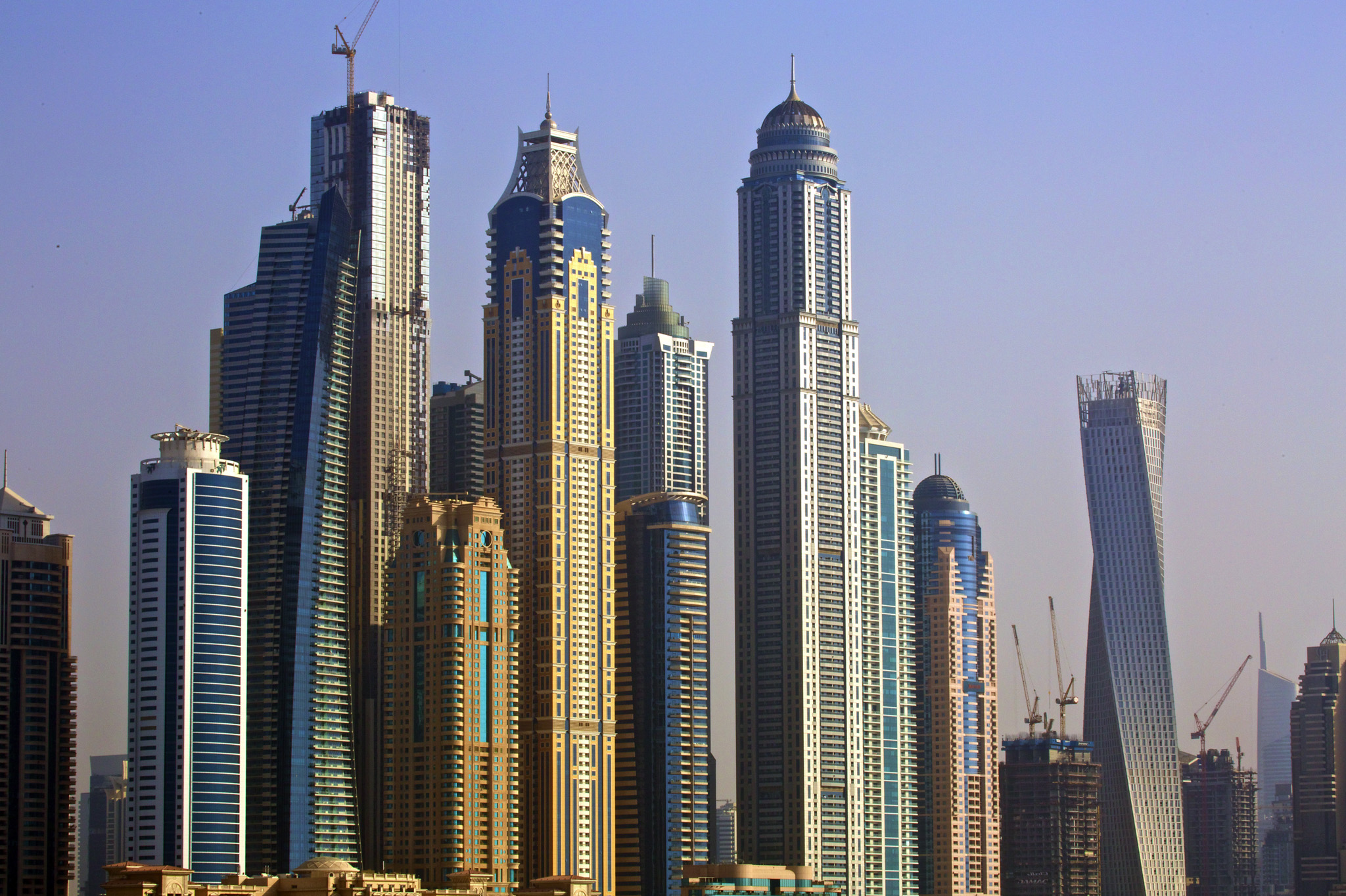 City skyscrapers stand on the waterfront on Palm Jumeirah artificial island in Dubai, United Arab Emirates.