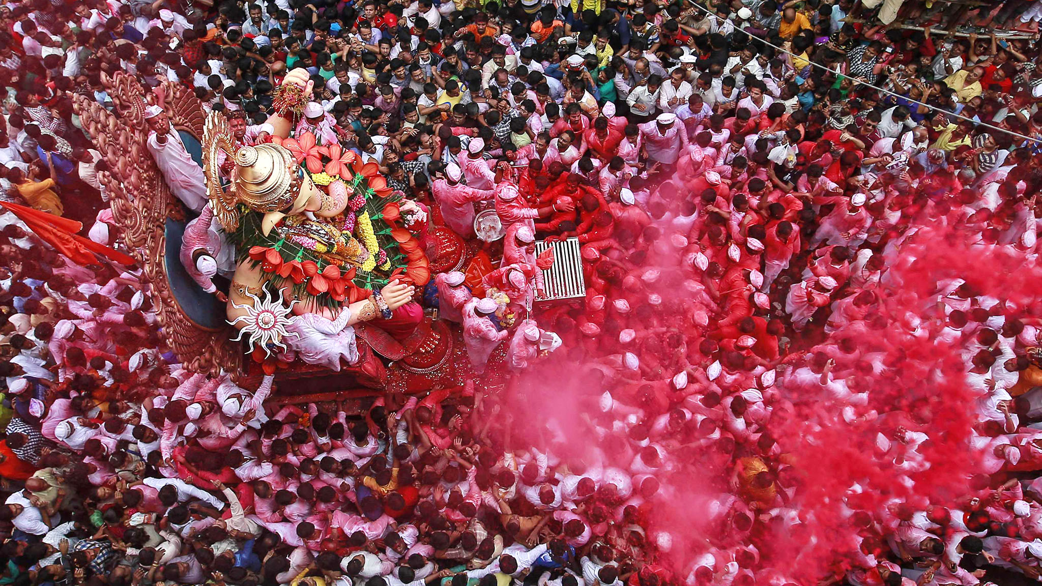 Devotees carry an idol of Hindu elephant god Ganesh, the deity of prosperity, during a procession through the streets before immersing it in the waters of the Arabian Sea on the last day of the Ganesh Chaturthi festival in Mumbai