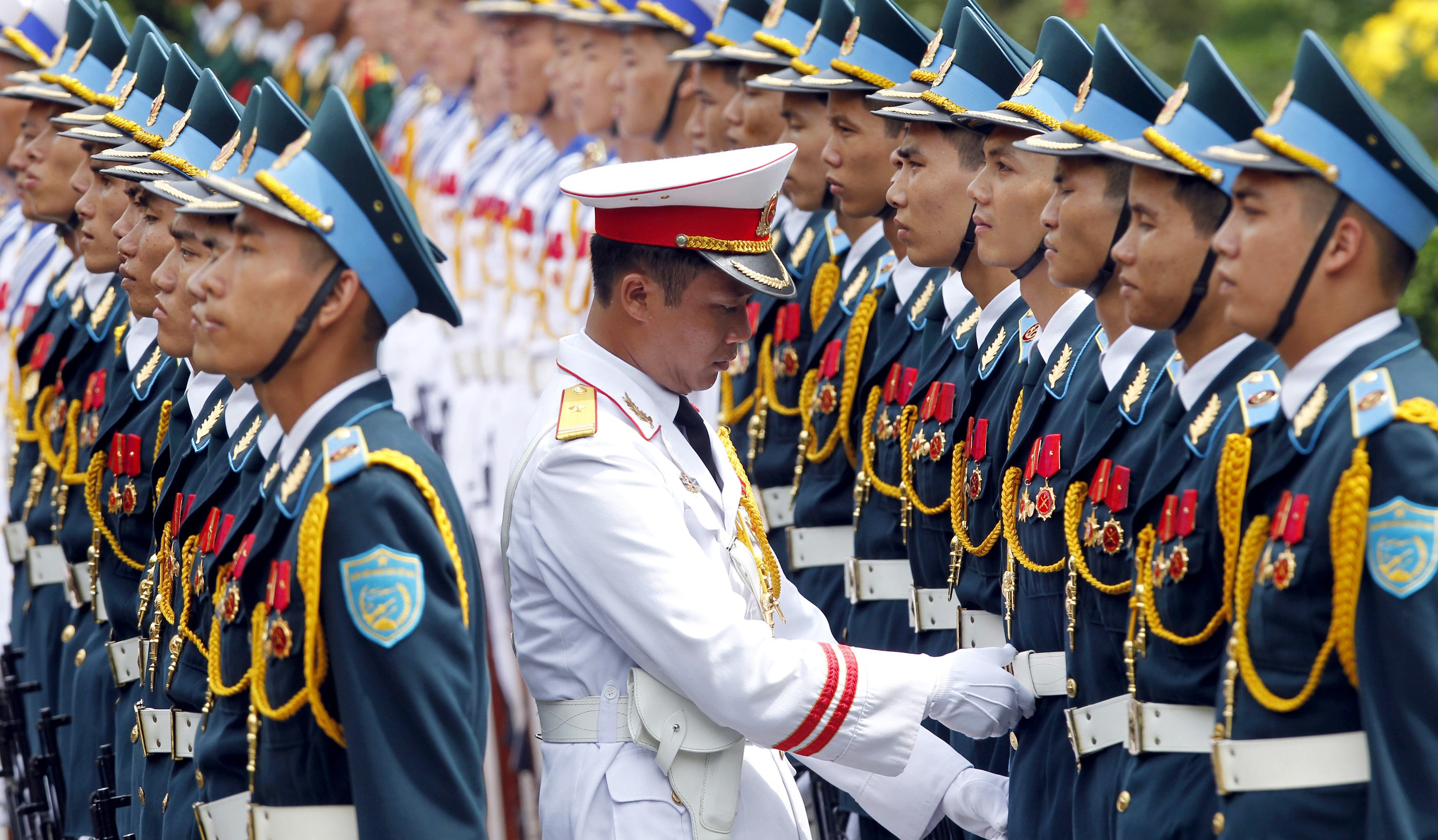 Tung checks the alignment of the honour guard before a welcoming ceremony for Mukherjee in Hanoi...Captain Bui Sy Tung checks the alignment of the honour guard before a welcoming ceremony for Indian President Pranab Mukherjee at the Presidential Palace in Hanoi September 15, 2014. REUTERS/Kham (VIETNAM - Tags: POLITICS MILITARY)