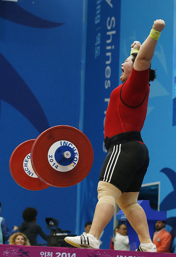 South Korea's Lee completes a lift in the women's over 75kg snatch weightlifting competition at the Moonlight Festival Garden during the 17th Asian Games in Incheon