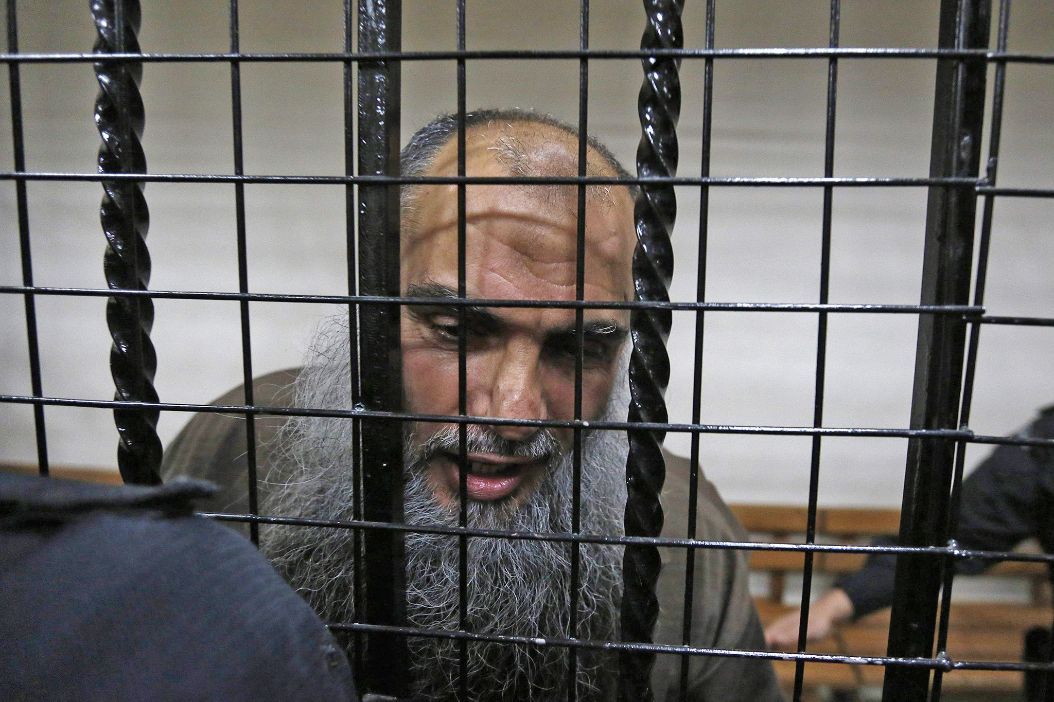 Radical Muslim cleric Abu Qatada speaks to the media after he was acquitted at the State Security Court in Amman