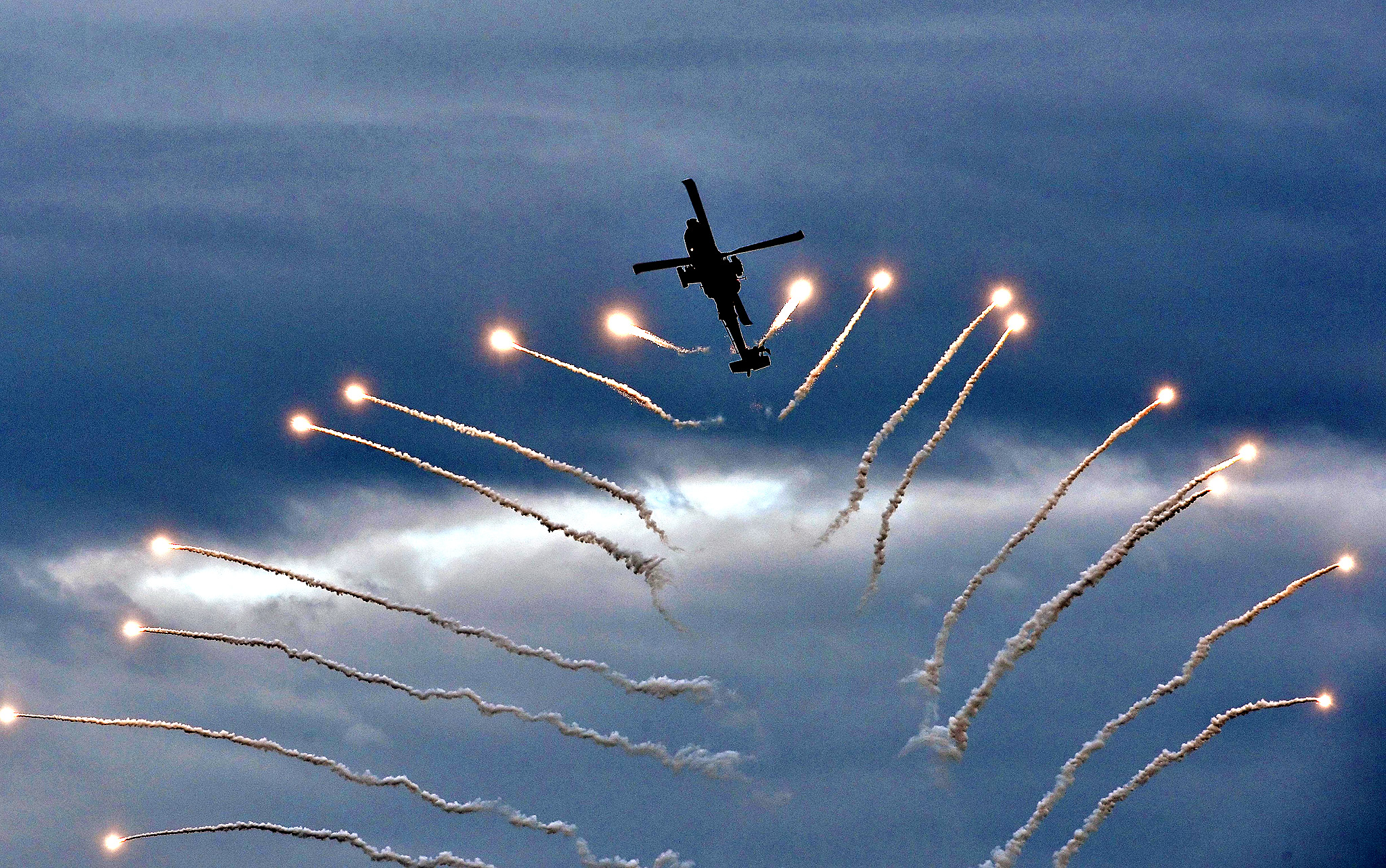 A Greek Army Apache helicopter takes part in an air show at Athens Paleo Faliro coastal suburb  on September 25 , 2014. The show was a pre-event for  Athens annual Flying Week  at the weekend at an airfield north of Athens.