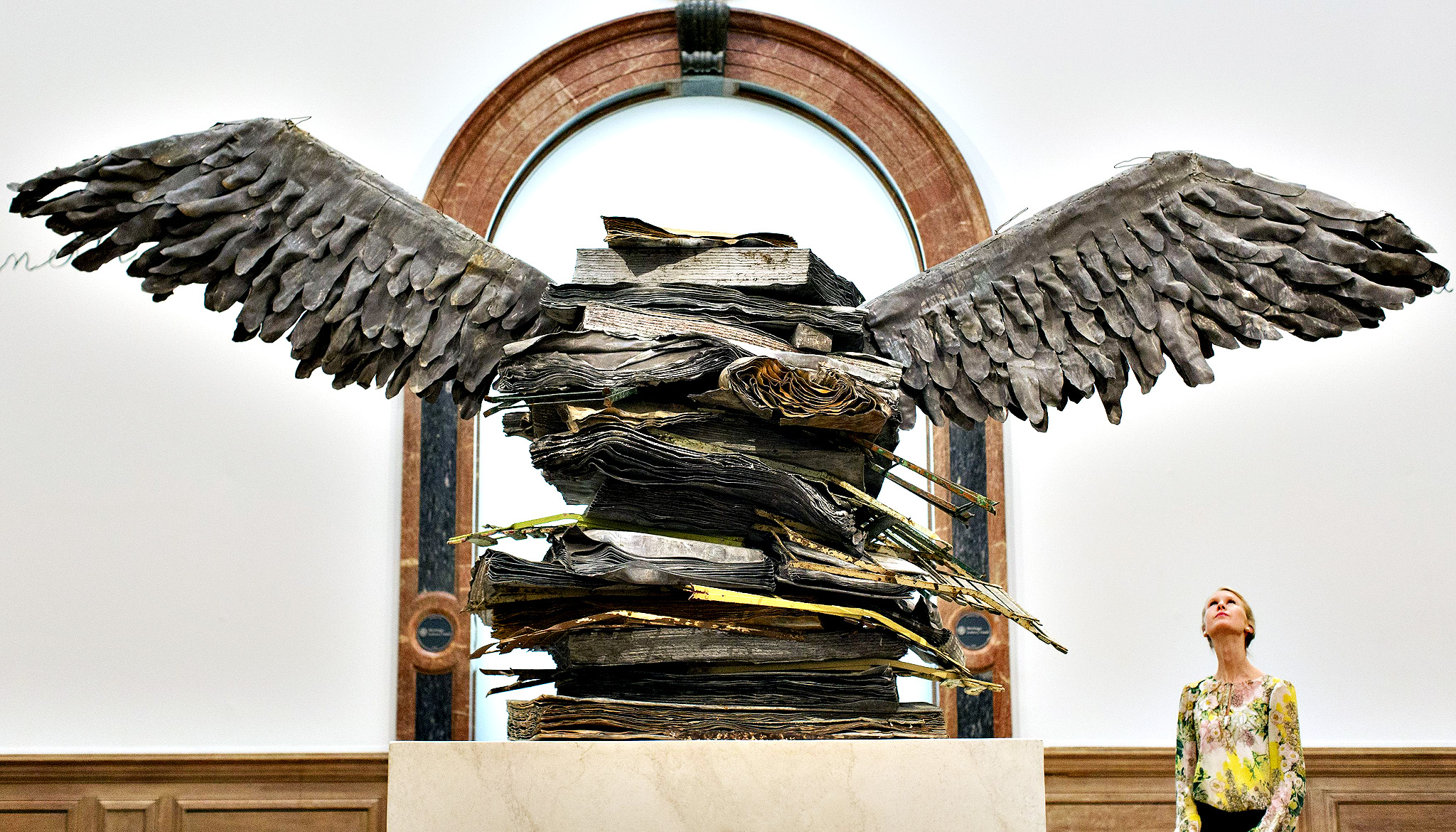 A gallery assistant stands next to 'Language of The Birds' by Anselm Kiefer, which forms part of a major new exhibition at the Royal Academy of Arts, in London.