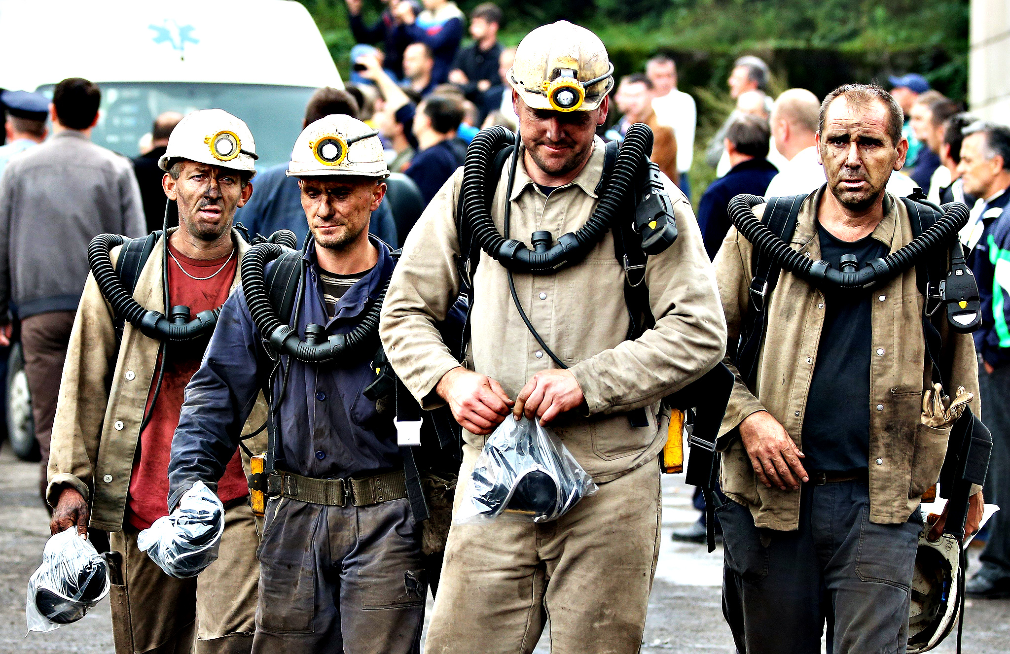 Bosnian rescue miners return from a mission underground at the coal mine Raspotocje in the central Bosnian town of Zenica, Bosnia and Herzegovina, 05 September 2014. Rescuers are attempting to reach at least five miners still trapped in the Bosnian coal mine after a tunnel partially collapsed, local media reported. The rescuers were in contact with the 34 miners on the other side of the cave-in caused by a minor earthquake on 04 September. The 133-year-old mine at Zenica, some 60 kilometres northwest of Sarajevo, was already hit by cave-in in March 2014 injuring 11 miners, and another fatal accident in 2013.