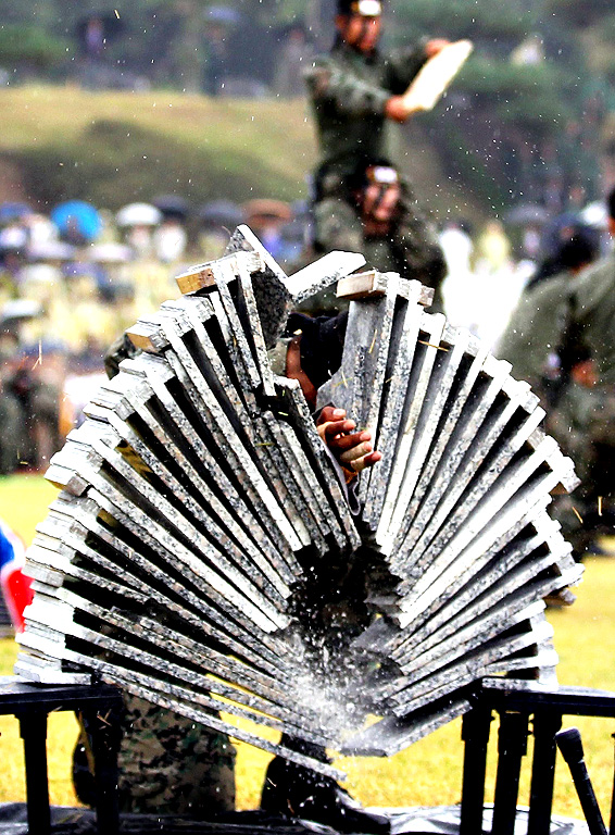 Soldiers demonstrate breaking boards at an event in the Gyeryongdae military headquarters in Gyeryong City, South Chungcheong Province, on Sept. 29, 2014, ahead of the 66th anniversary of the foundation of the country's military, which falls on Oct. 1.
