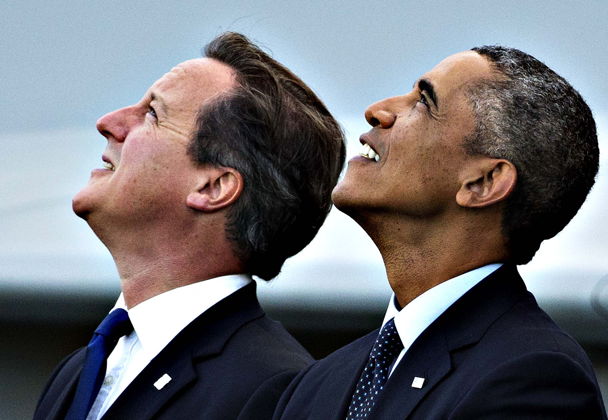 U.S. President Barack Obama and British Prime Minister David Cameron, left, watch a flypast on the second day of a NATO summit at the Celtic Manor Resort in Newport, Wales on Friday, Sept. 5, 2014.