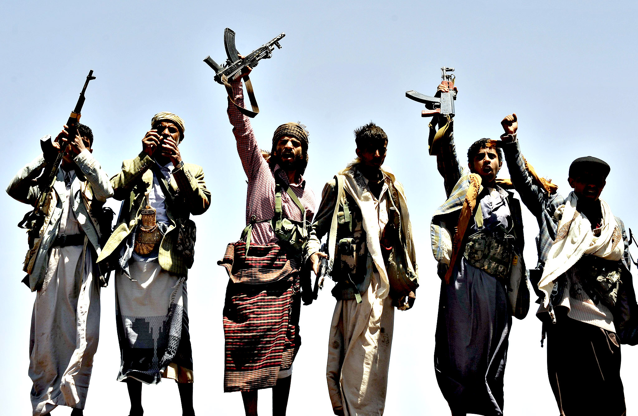 Shiite fighters seized control of the capital Sana a...epa04411989 Gunmen of the Shiite Houthi movement shout anti-Government slogans as they stand on a hill overlooking the capital  after they consolidated their foothold in Sana'a, Yemen, 22 September 2014. Reports state the Yemeni government and Shiite Houthi rebels on 21 September signed a UN-brokered ceasefire hours after Houthi insurgents captured major state institutions in the Arabian Peninsula country's worst crisis in three years.  The deal, including calls for an immediate ceasefire, the formation of a national unity government and economic reforms, was announced after four days of heavy fighting in Sana'a, pitting the Houthis against Sunni rivals backed by government forces.