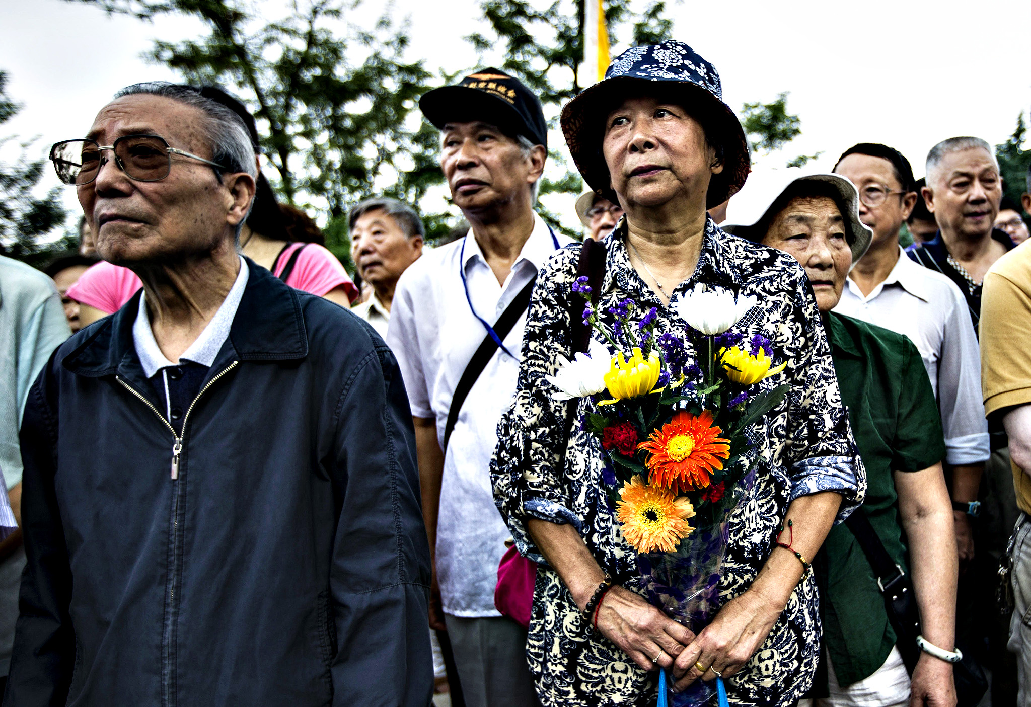 People gather to pay tribute to people who died in battles against Japan during World War II at the Aviation Martyr Memorial to commemorate the 69th anniversary of victory over Japan in World War II in Nanjing, east China's Jiangsu province on September 3, 2014. Chinese President Xi Jinping and all six other members of the Politburo Standing Committee, the country's most powerful body, made a rare public appearance on September 3 to commemorate 69 years since Japan's surrender at the end of World War II. The ceremony was the first since Beijing earlier this year declared September 3 as a national day to mark Japan's defeat -- it signed the formal surrender on board the USS Missouri in Tokyo Bay on September 2, 1945, with China celebrating the following day.