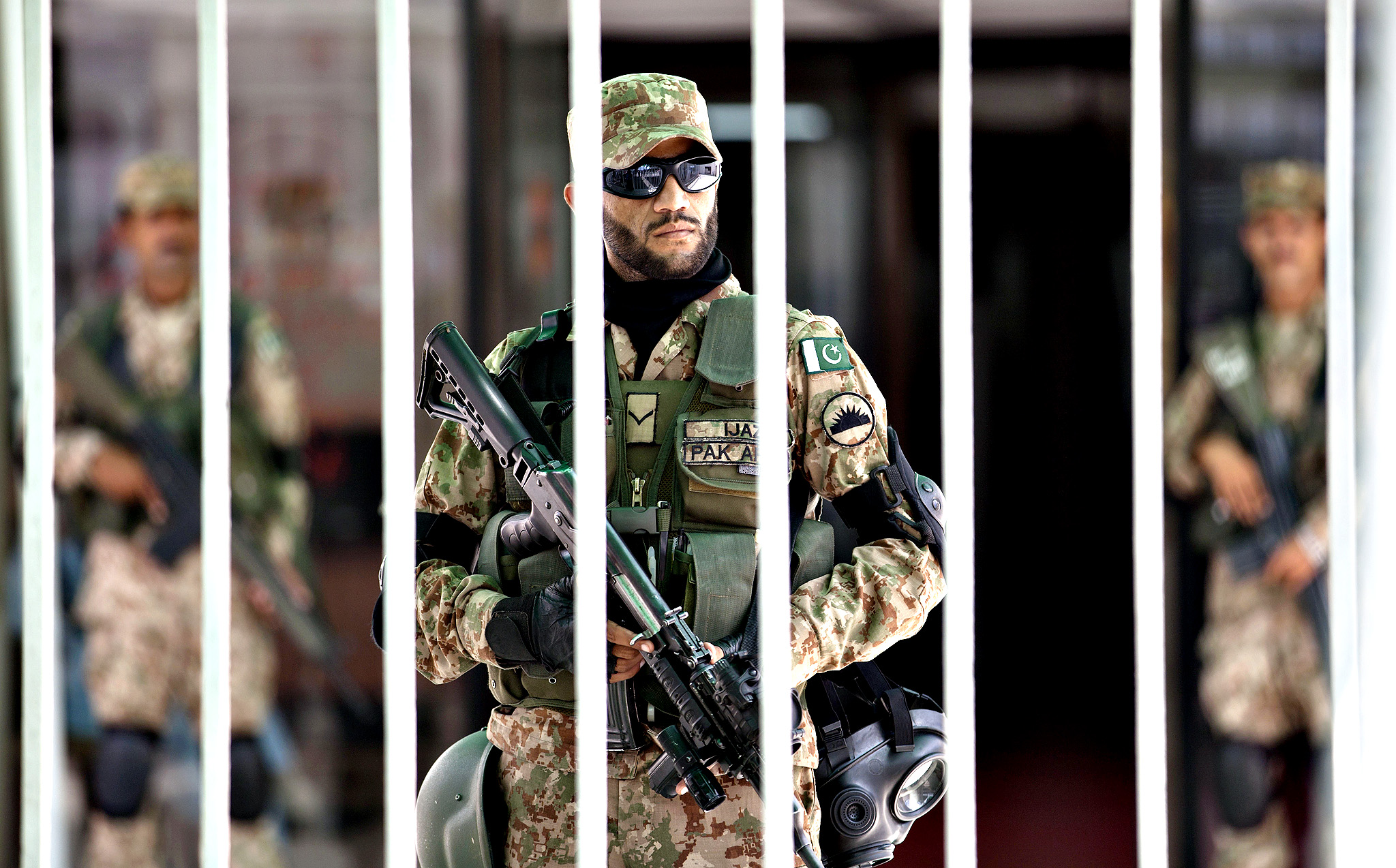 Pakistani army soldiers stand alert inside the parliament building during an emergency session in Islamabad, Pakistan, Tuesday, Sept. 2, 2014. Lawmakers met over the political crisis roiling the country as thousands of anti-government protesters remained camped out in front of the parliament building, demanding Prime Minister Nawaz Sharif resign.